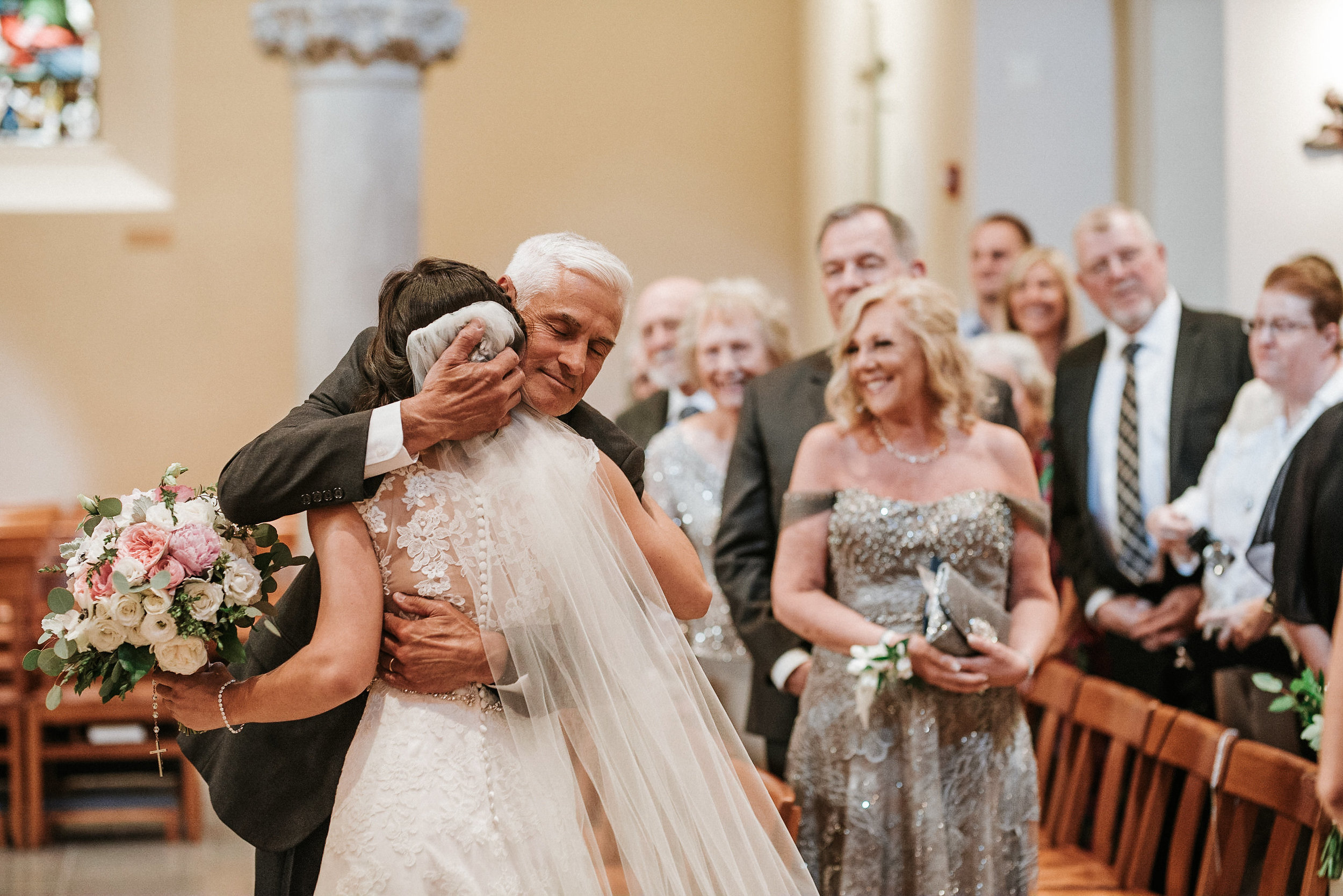 Father hugging bride