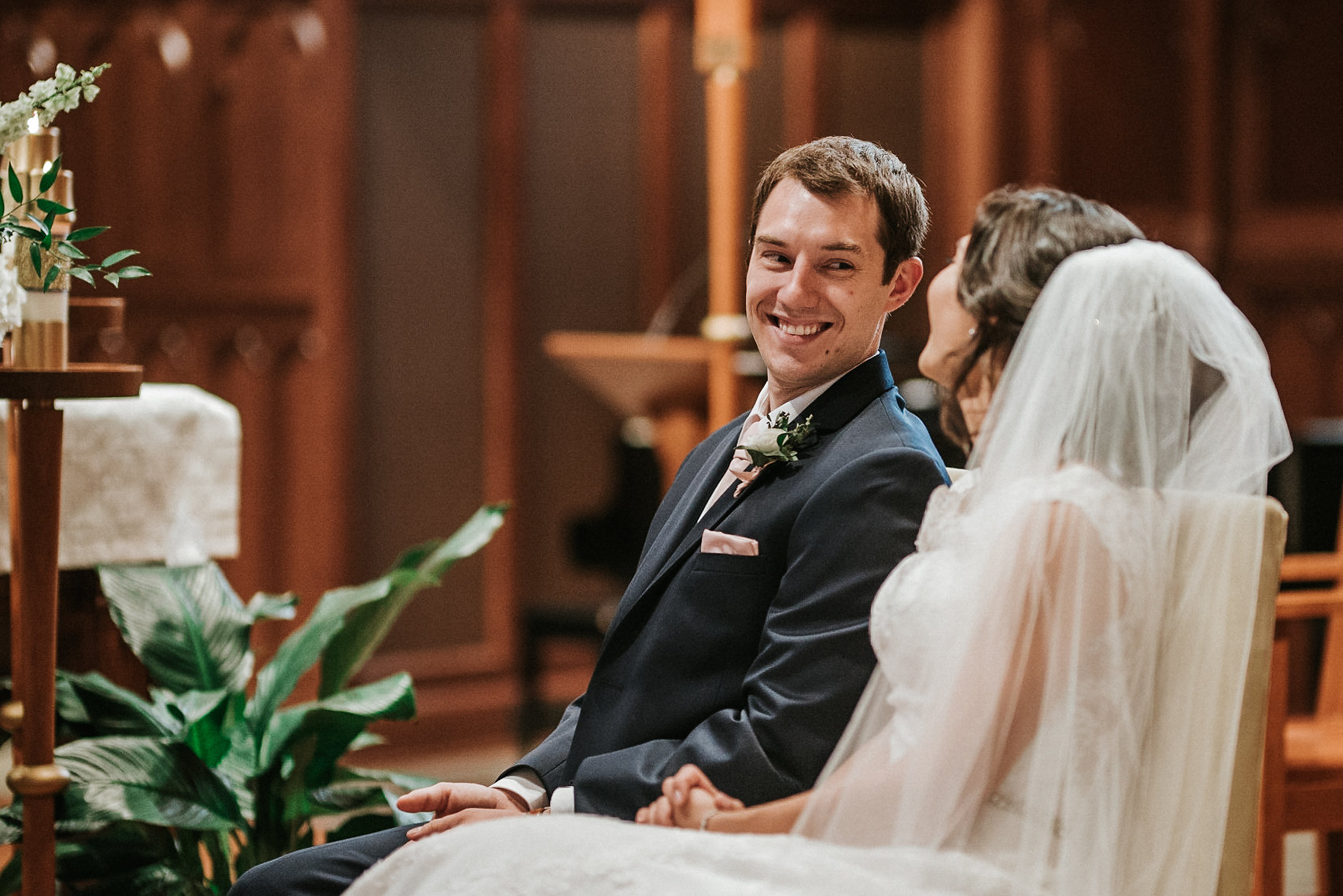 Bride and groom smiling at one another during wedding