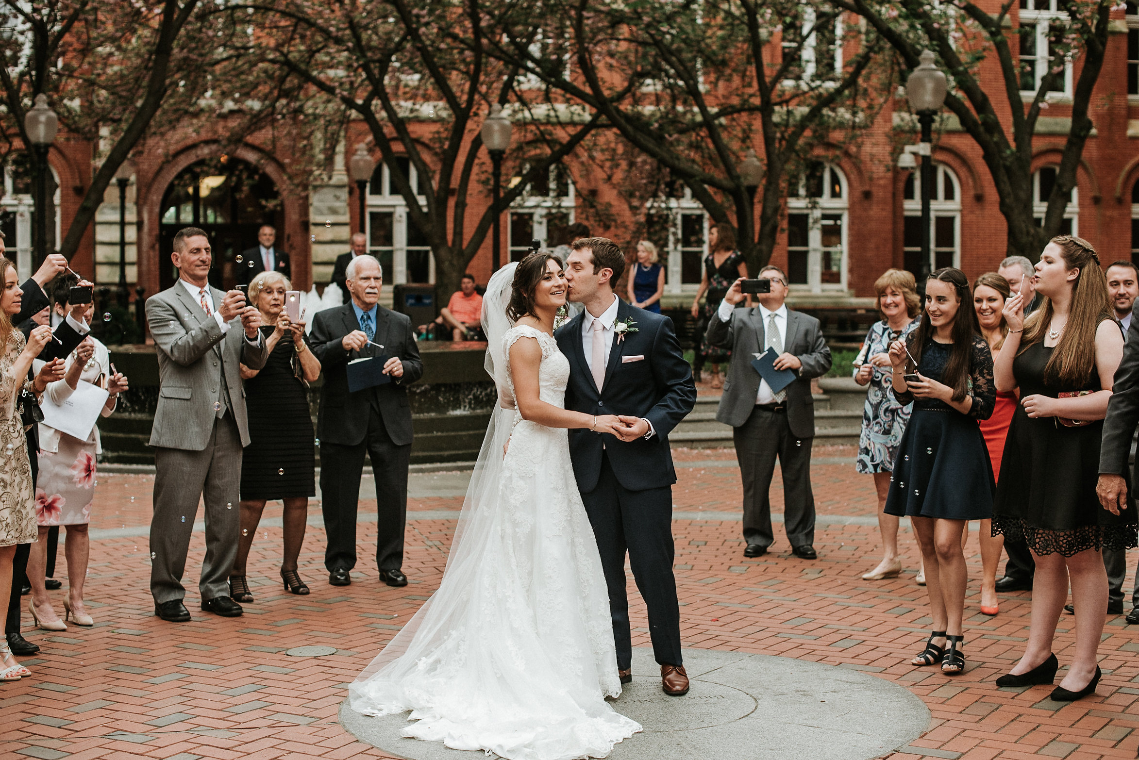 Bride and groom in church courtyard
