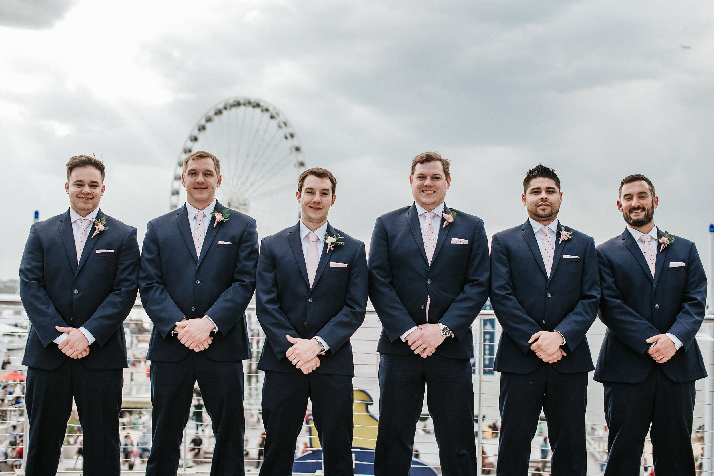 Groomsmen in front of ferris wheel