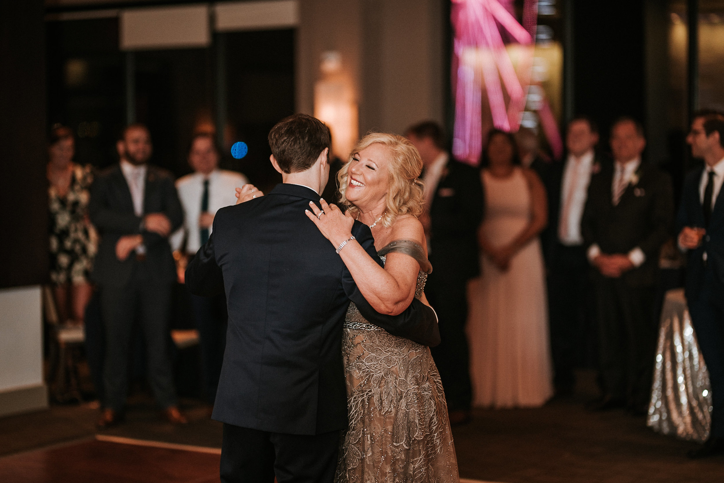 Son and mother dance at reception