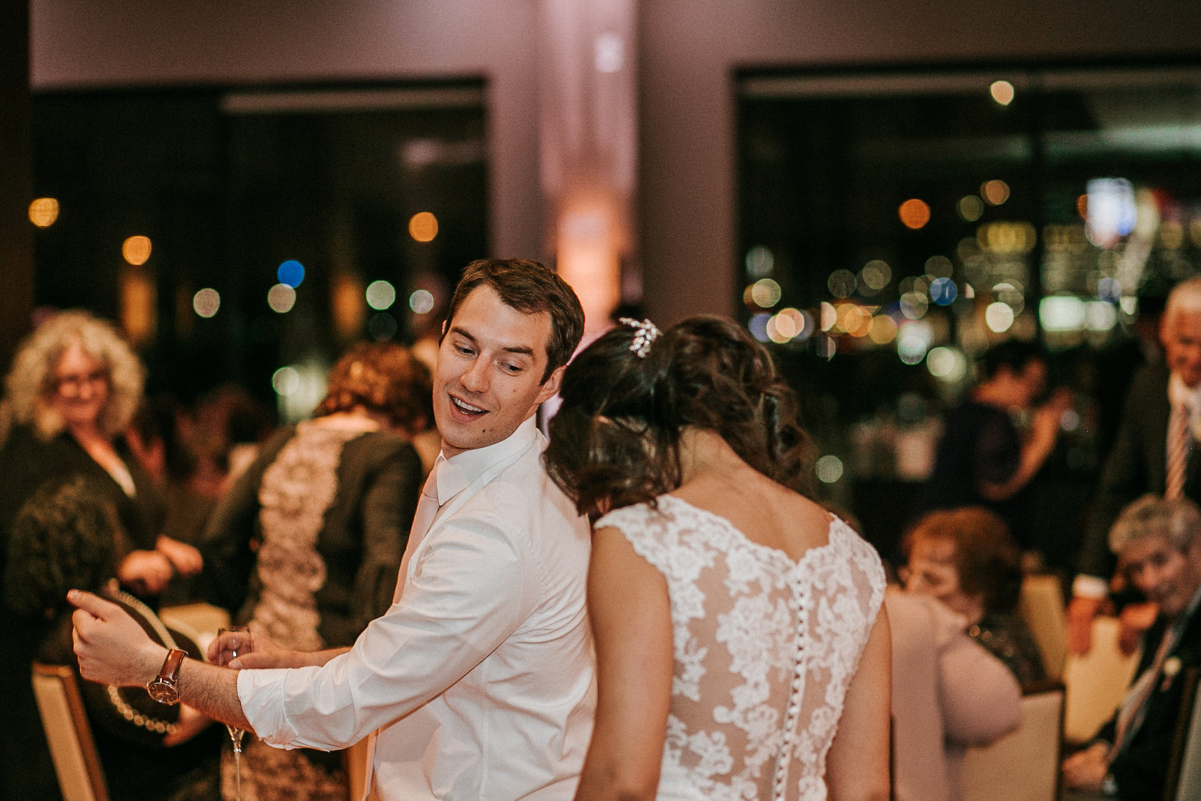 Groom and bride dancing at reception