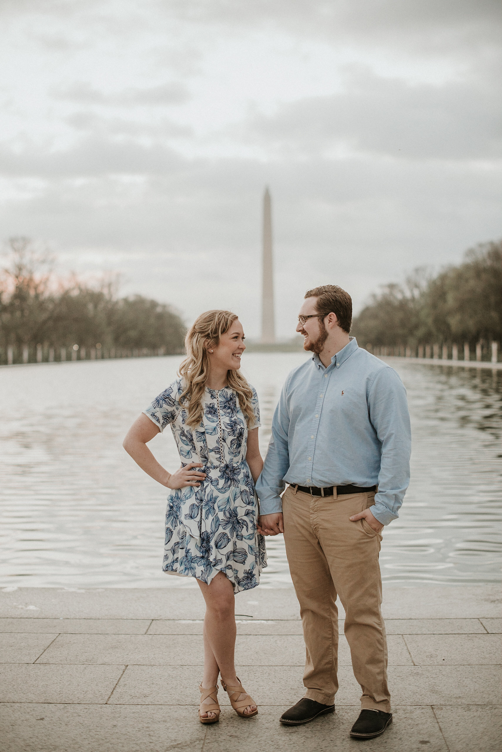 Couple standing in front of Washington Memorial