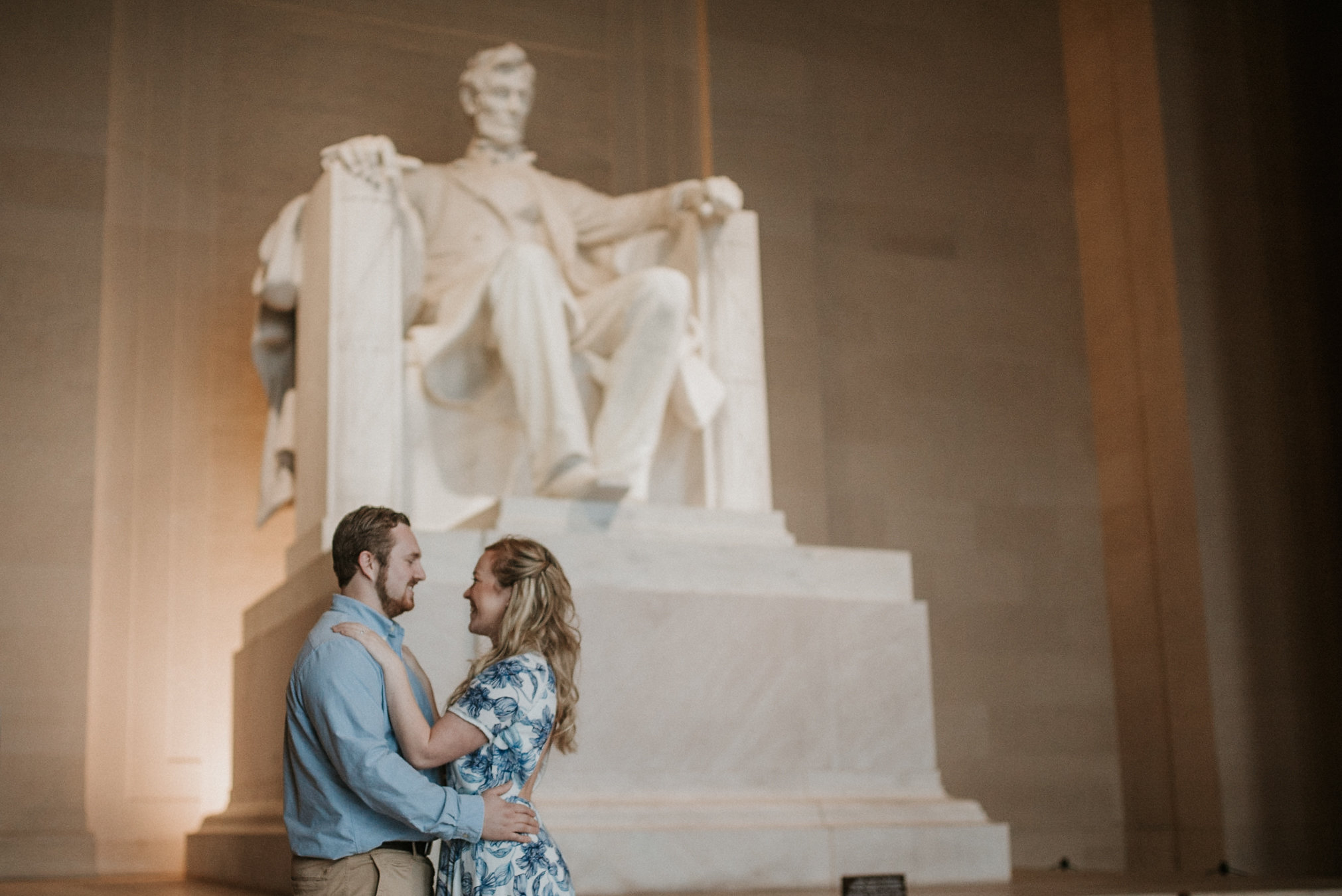 Couple hugging in front of Lincoln Memorial