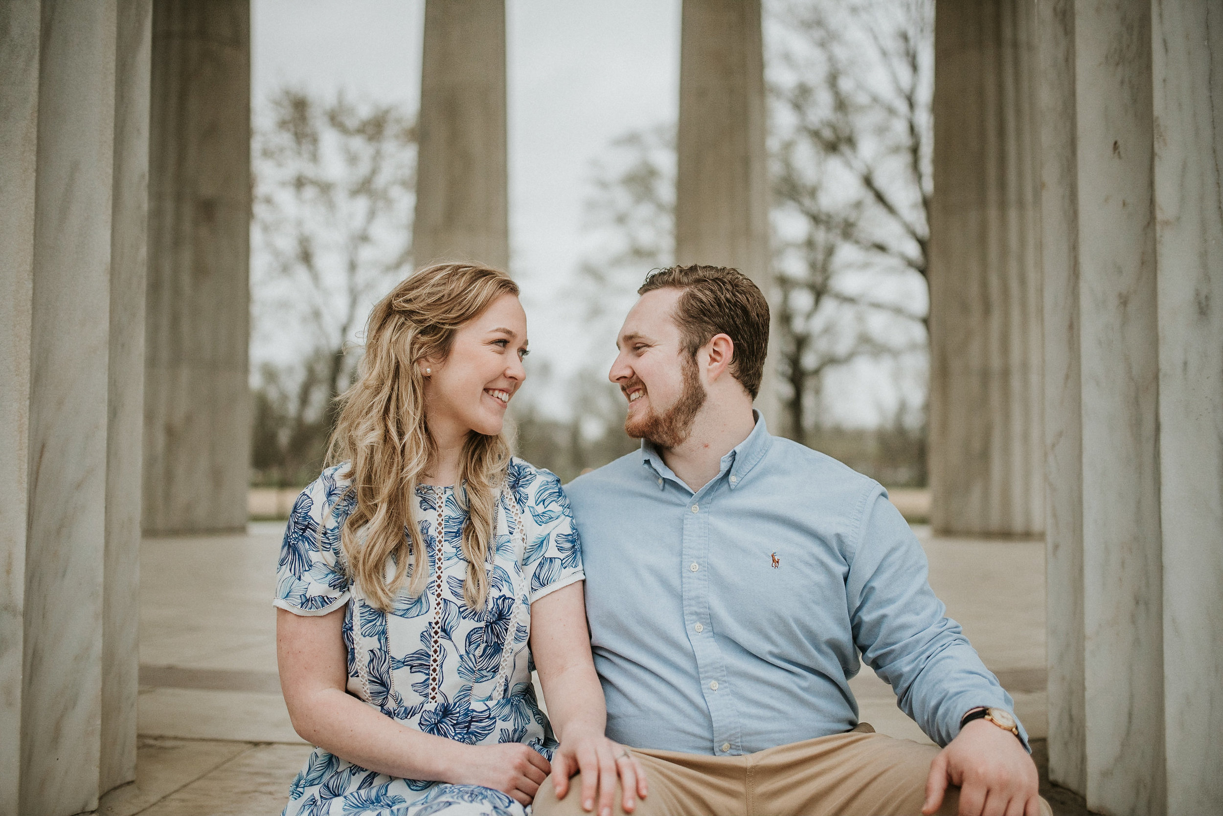 Couple smiling at one another on steps