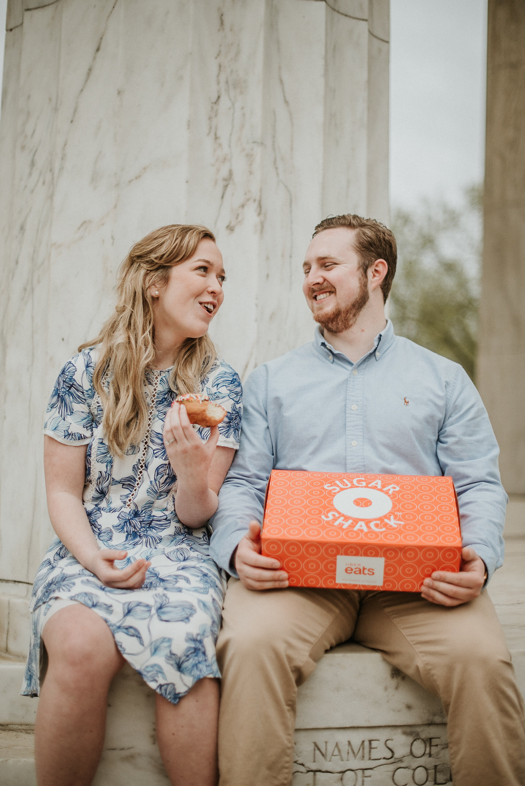 Couple sharing box of donuts