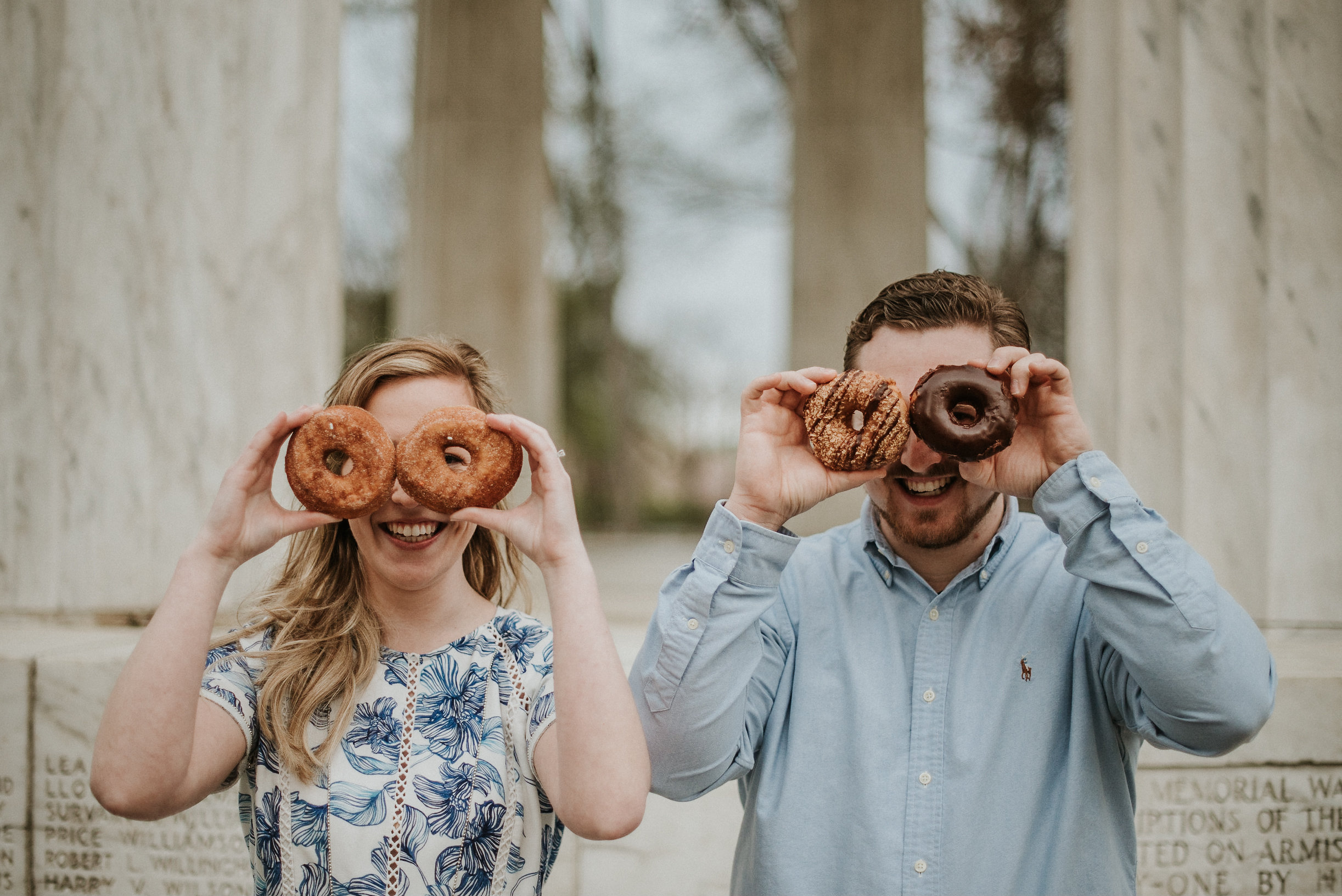 Silly couple with donuts