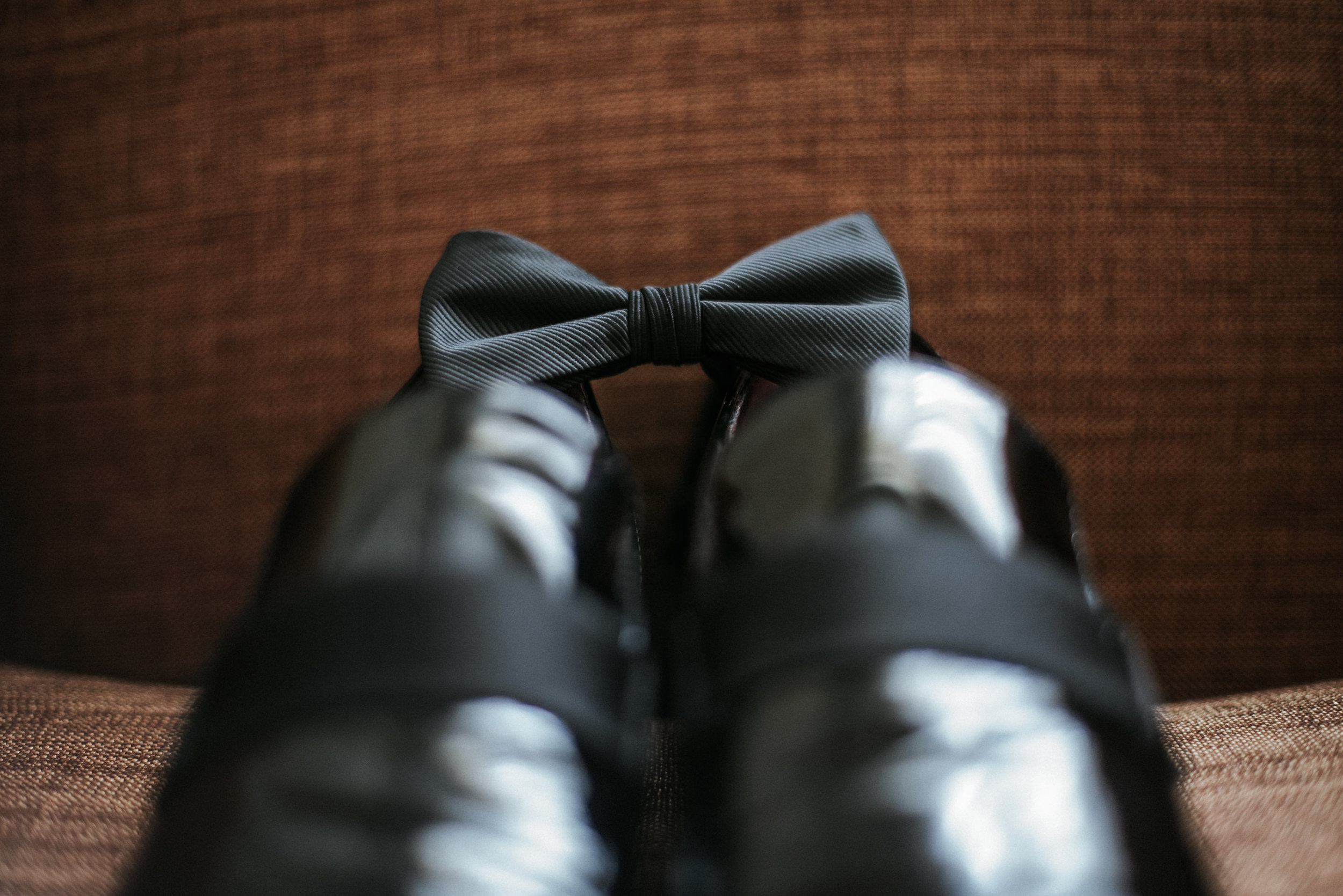 Groom's bow tie on black shoes