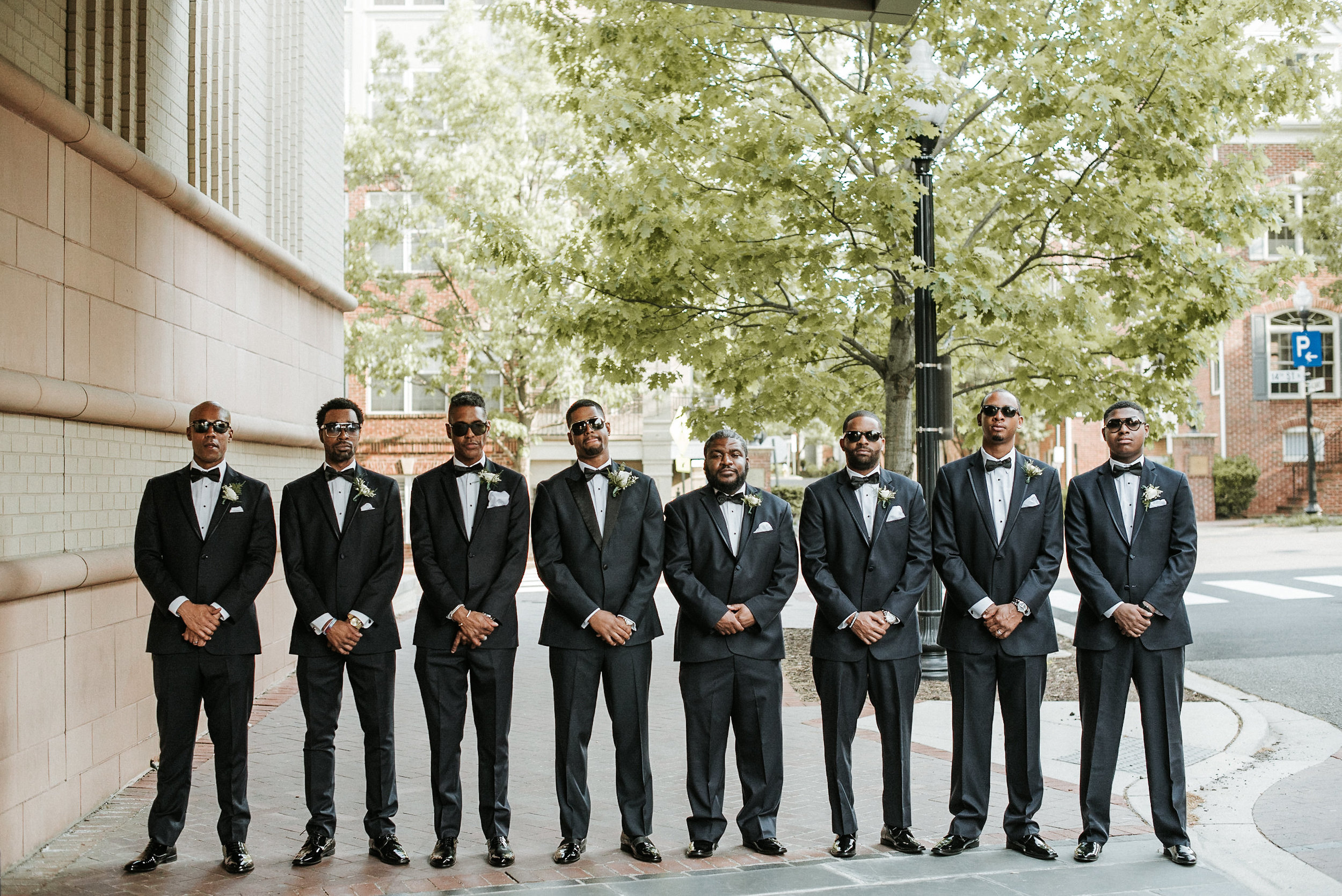 Groomsmen in front of hotel