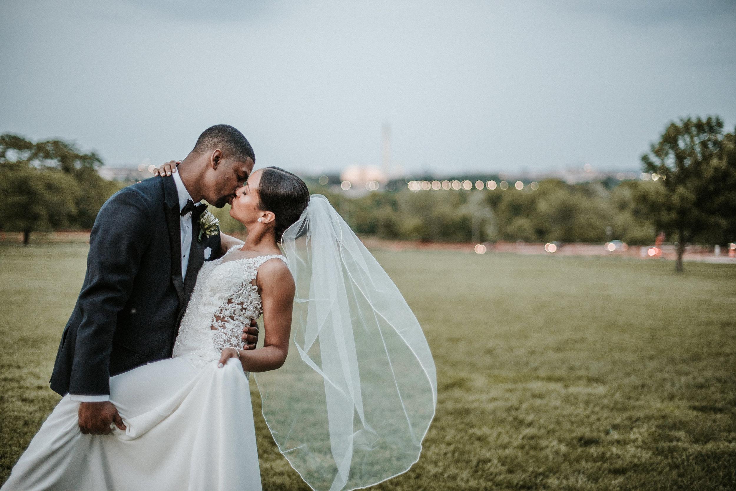 Groom dipping bride in kiss