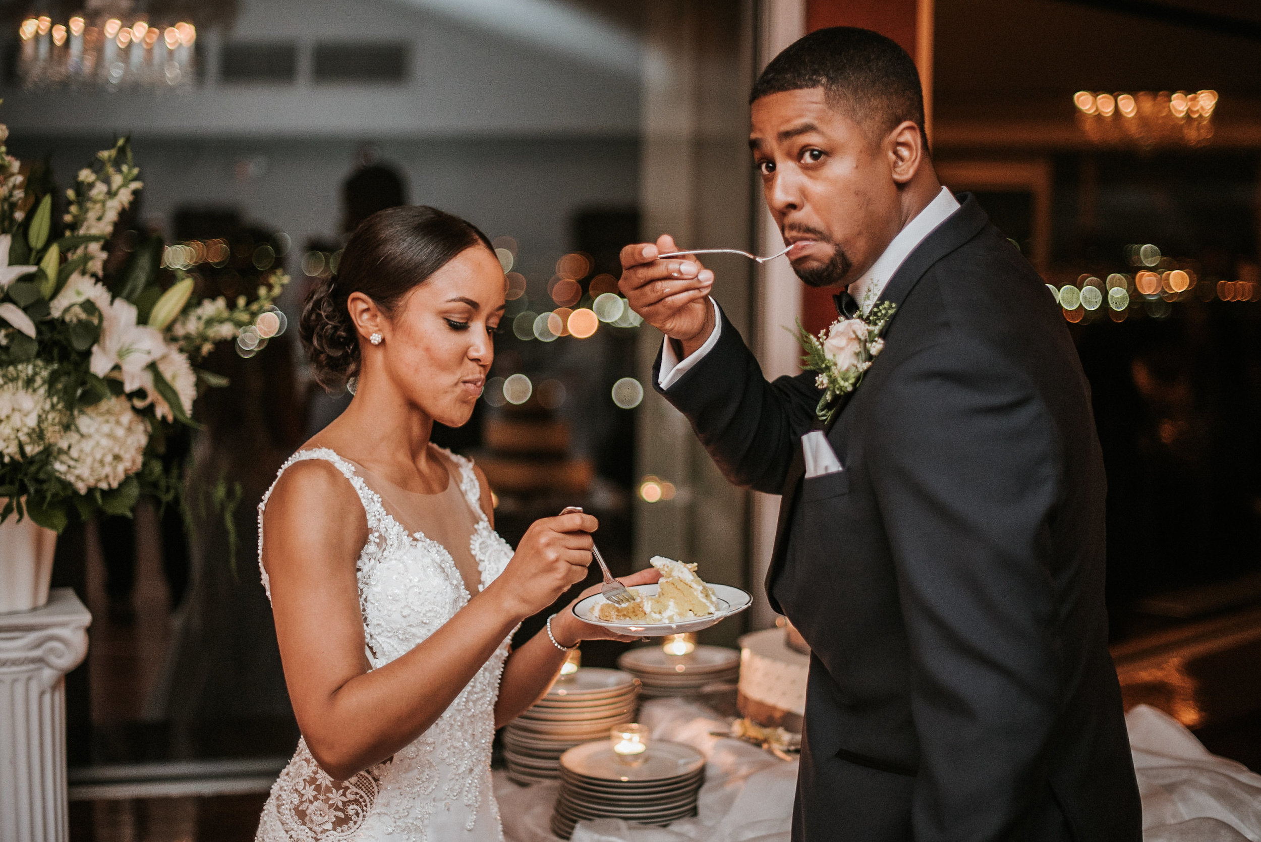 Groom and bride eating cake