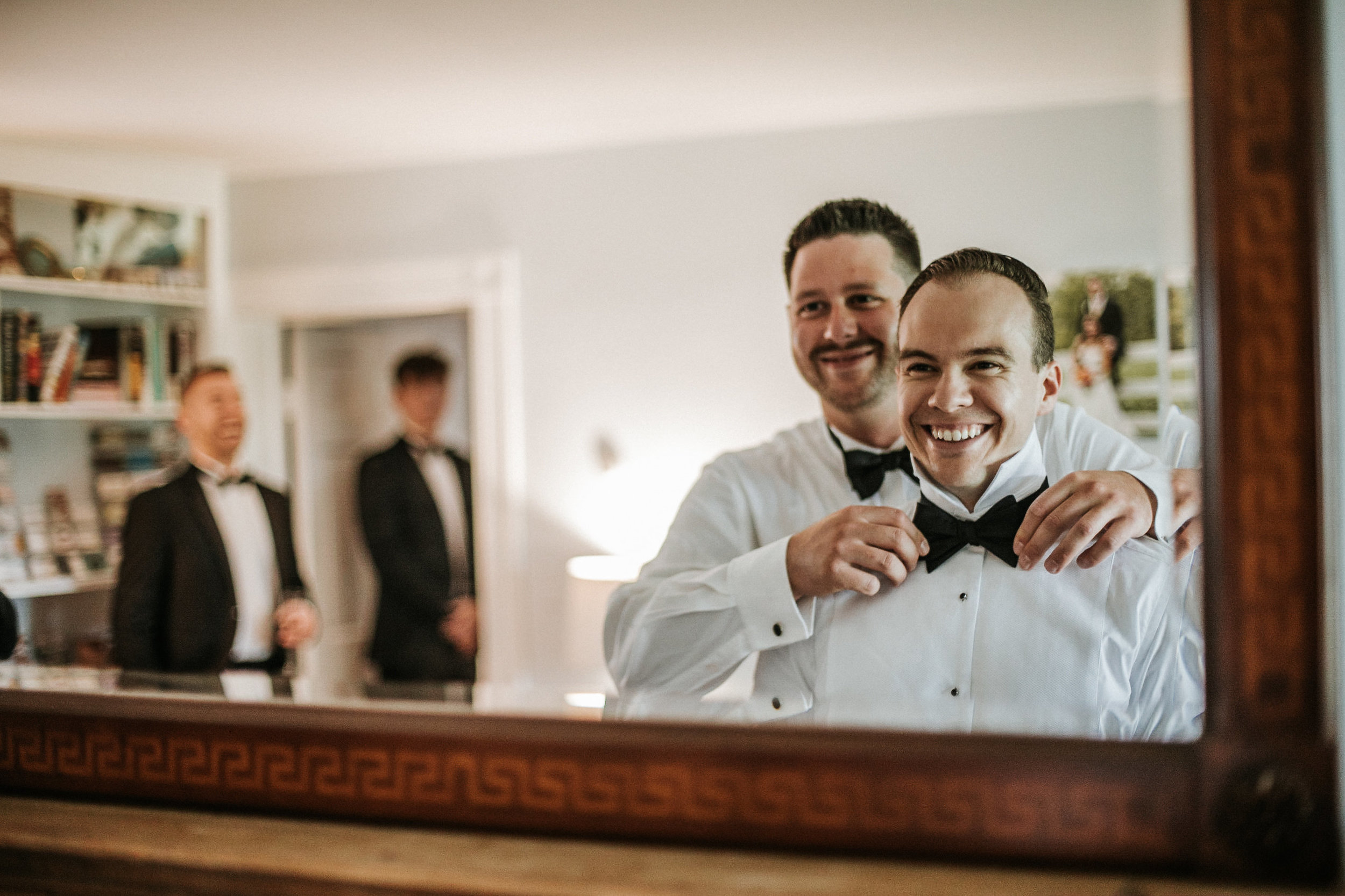 Groom smiling in mirror
