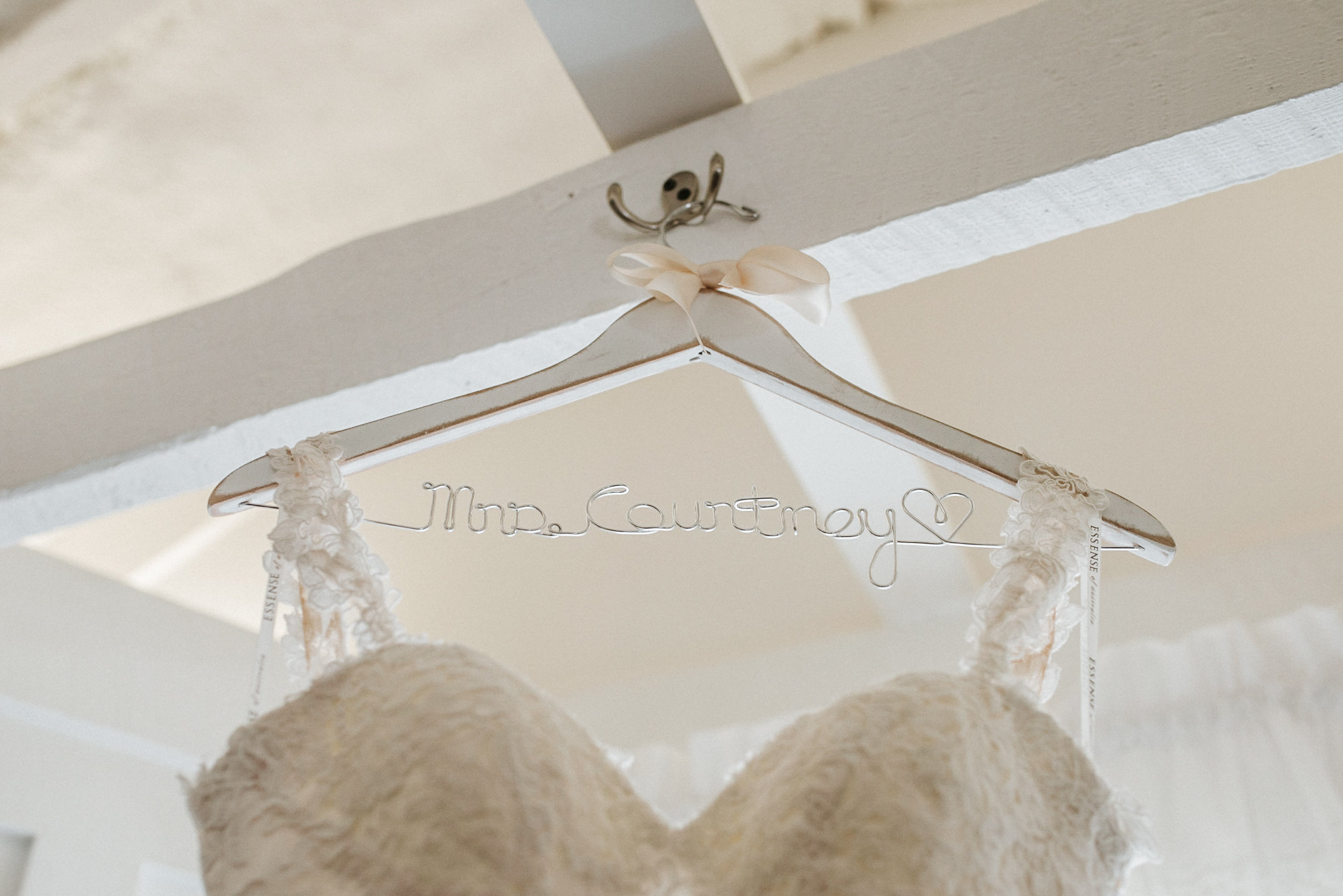 Bride's dress hanging from hook