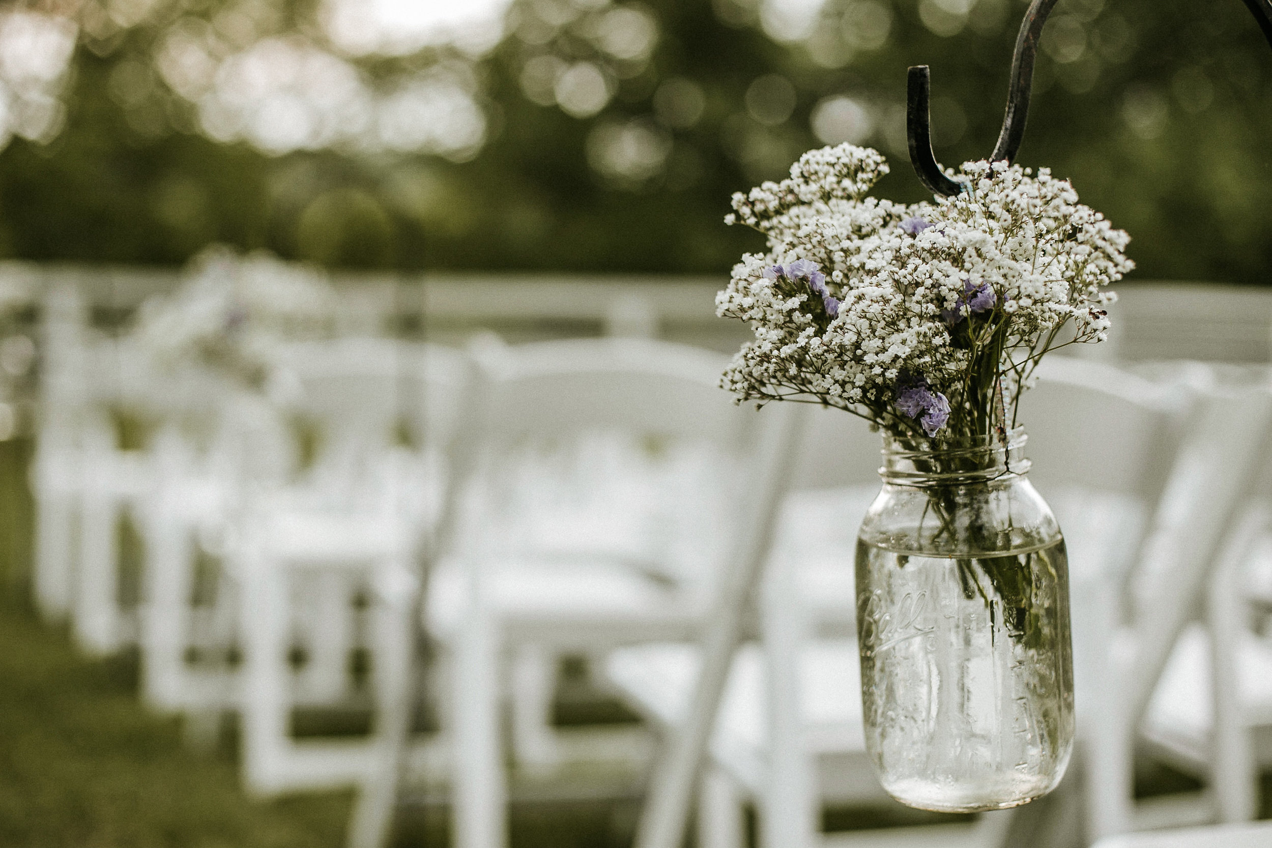 Baby's Breath in Mason jars for wedding