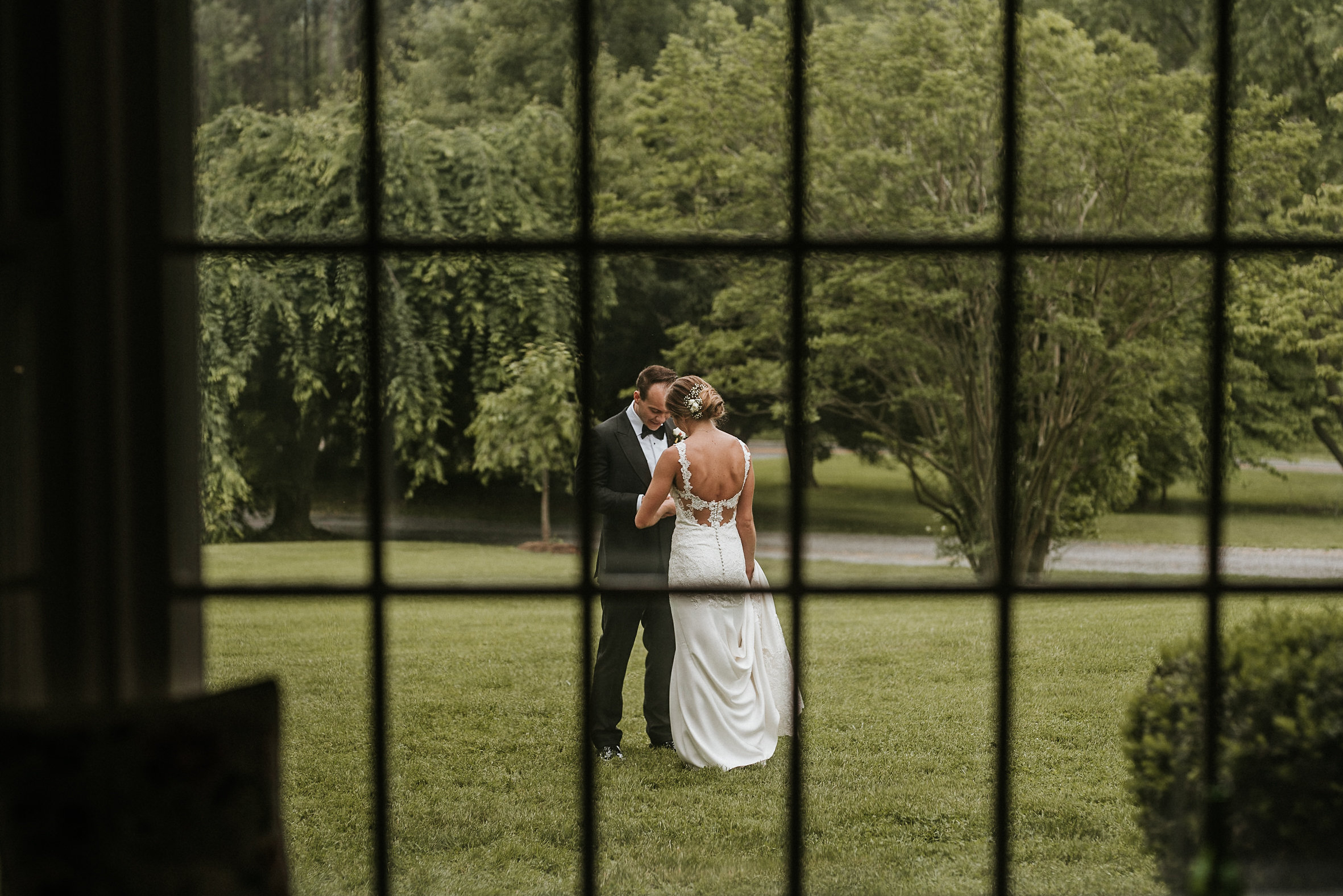 Bride and groom seen through window