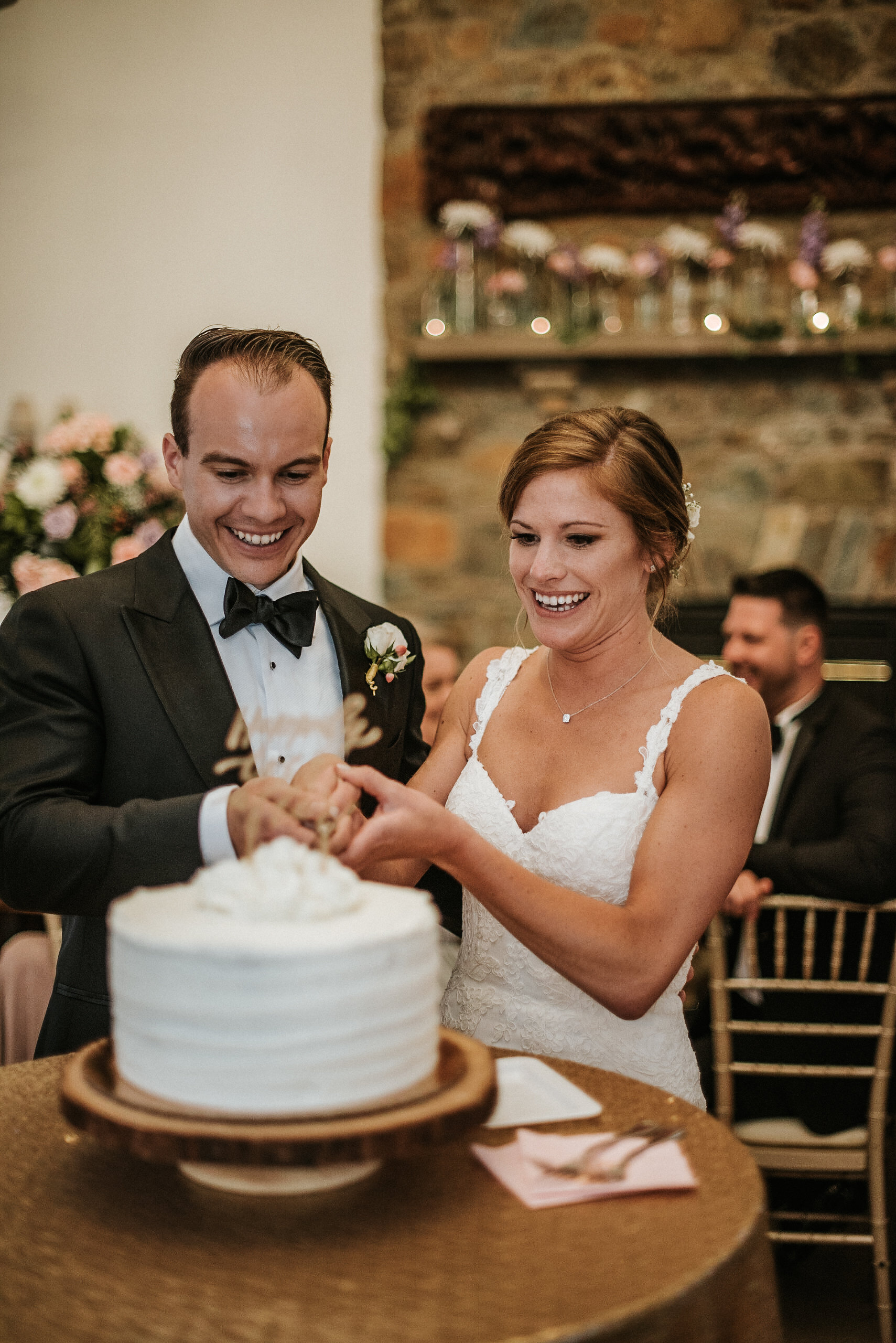 Goom and bride cutting cake