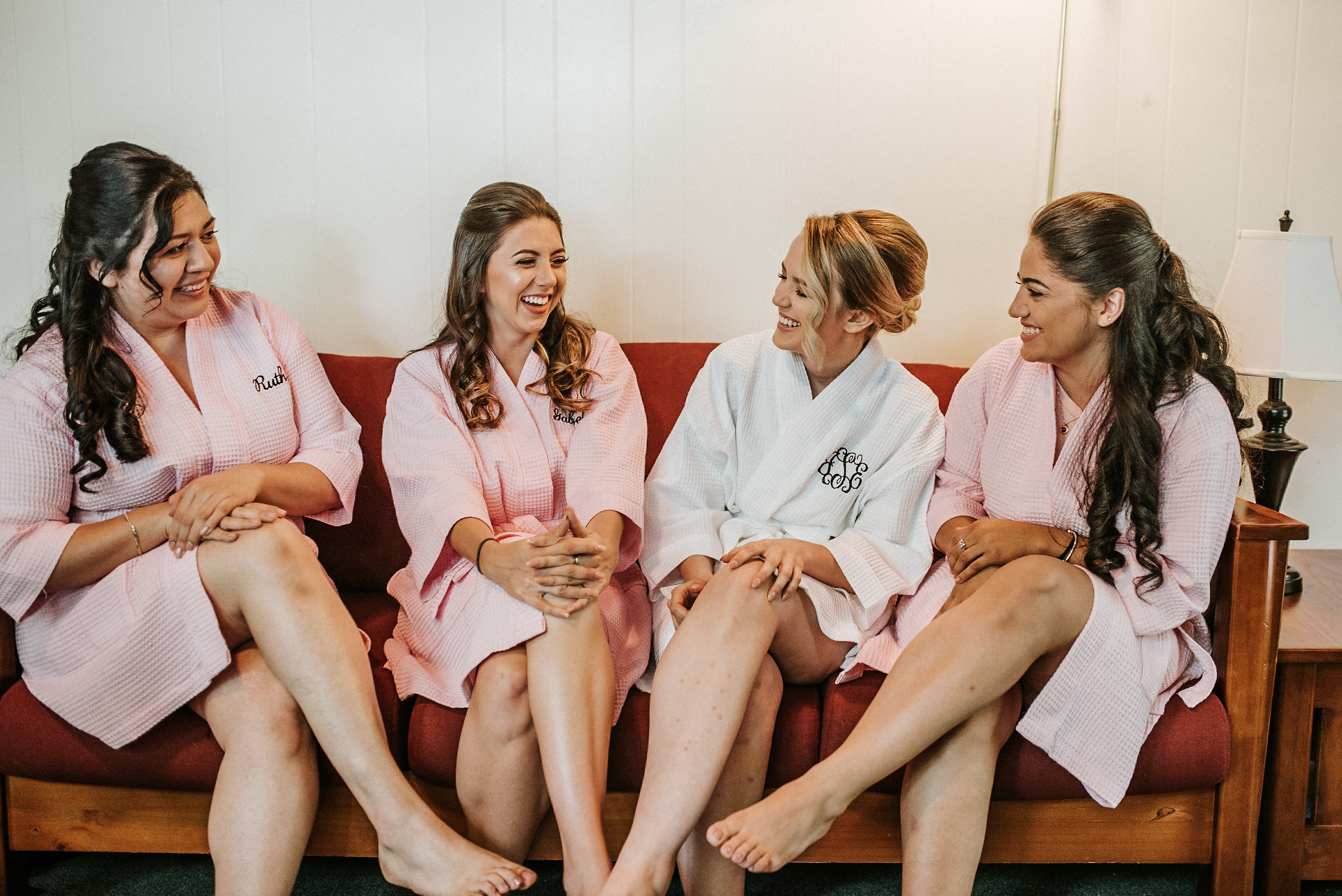Bridal party matching white and pink robes