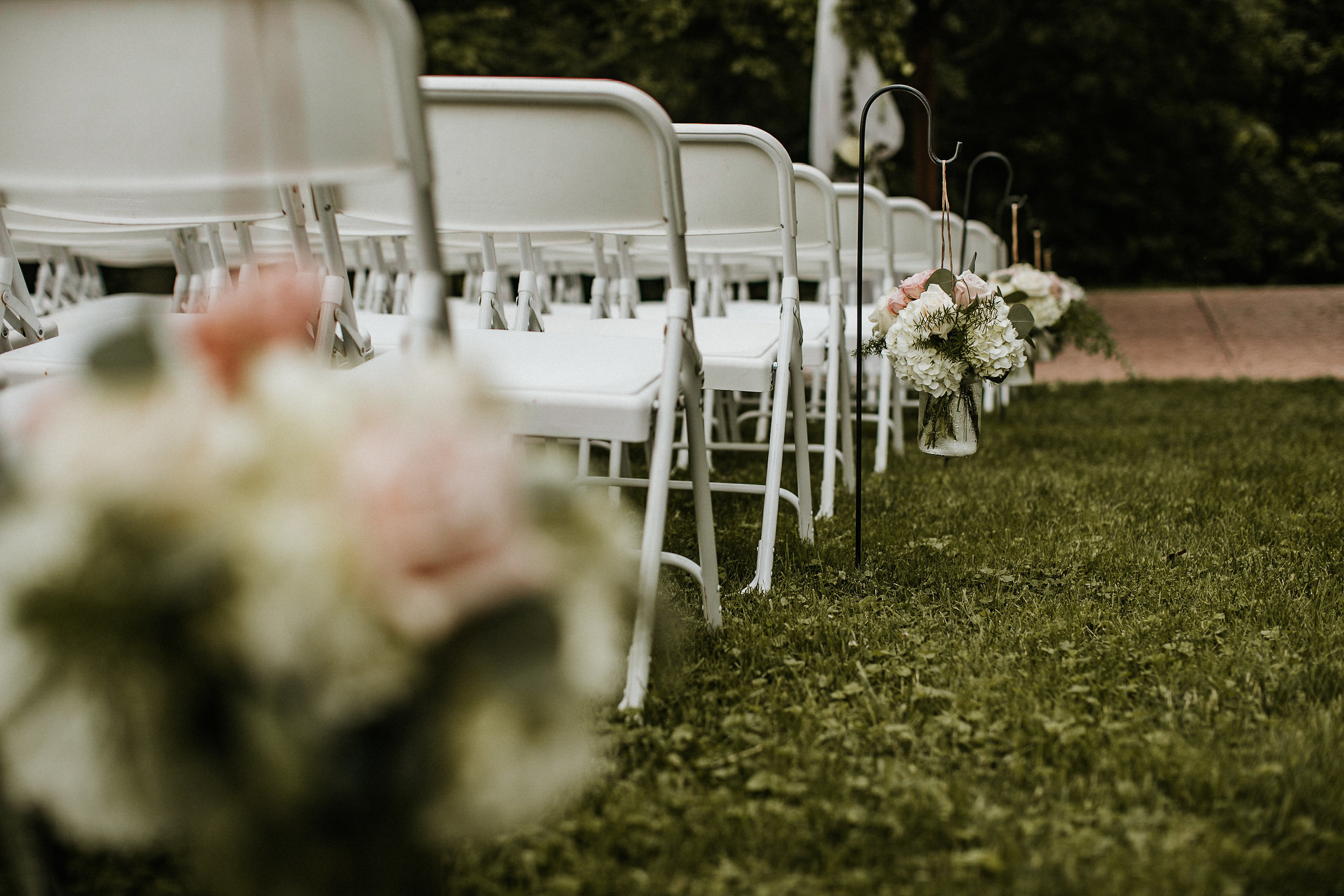 Wedding flowers and folding chairs
