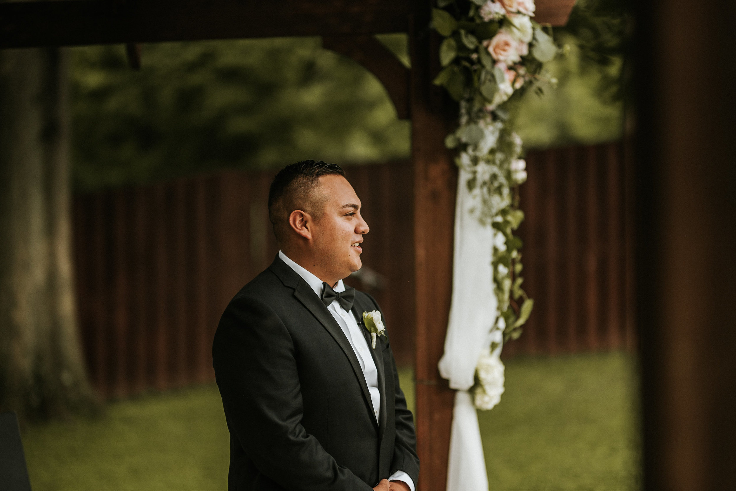 Groom at front of aisle during ceremony