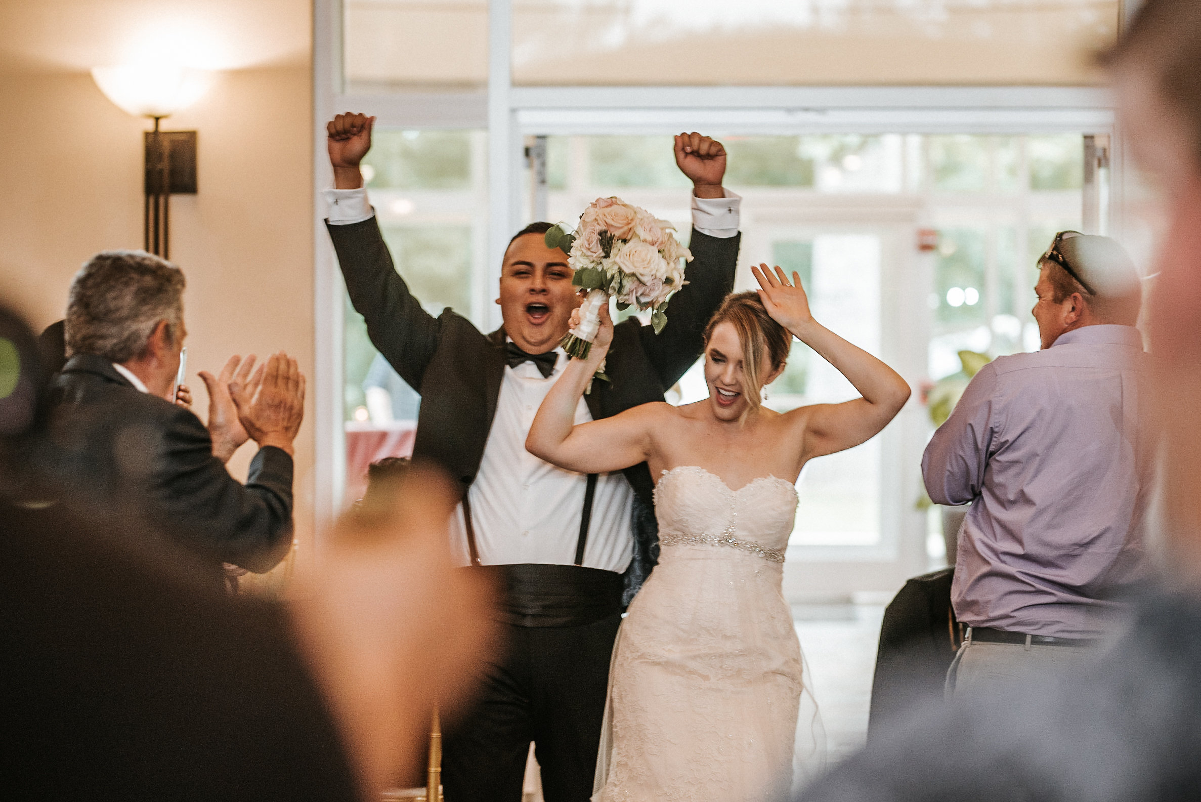 Bride and groom enetering reception