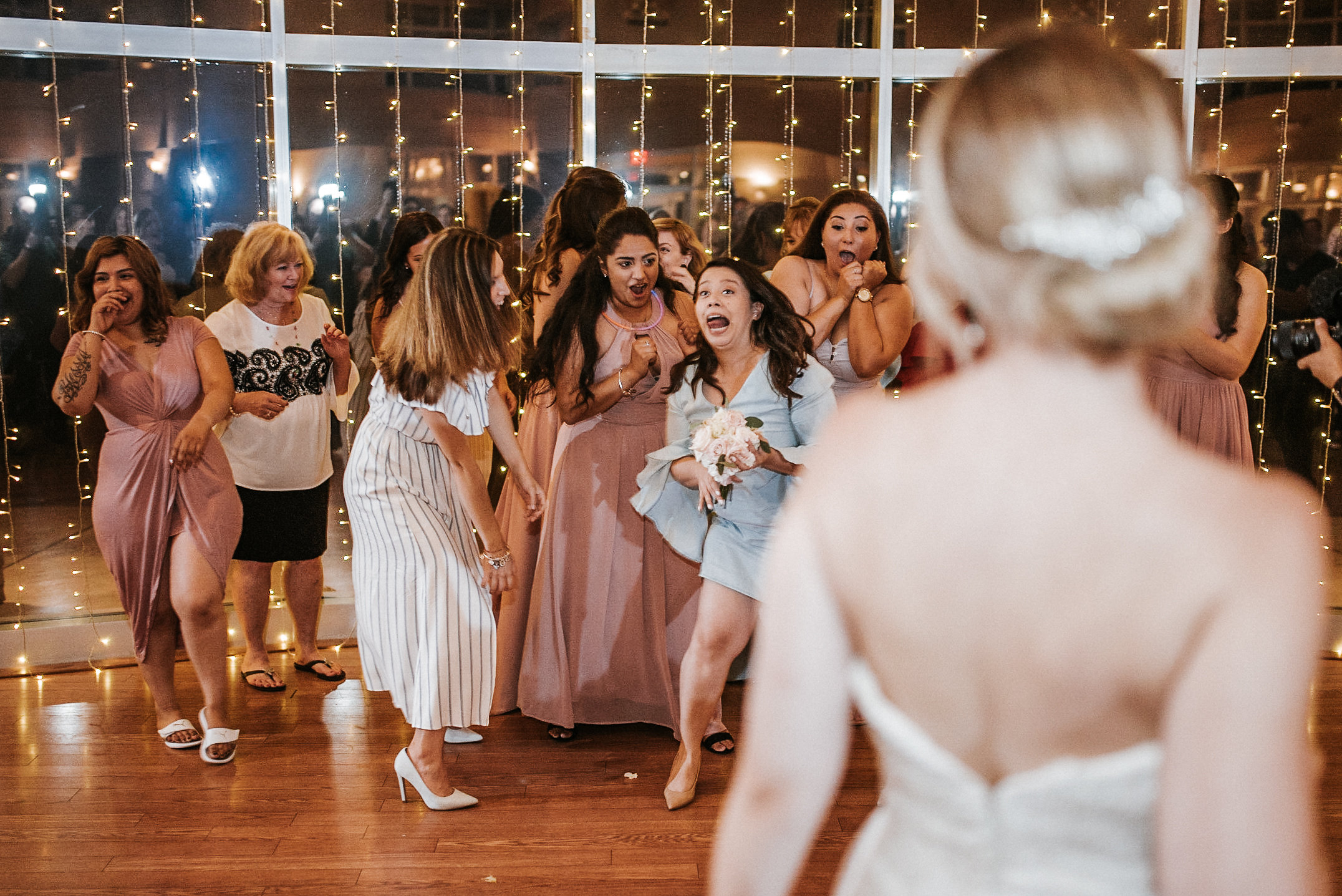 Bridesmaids fighting over bouquet