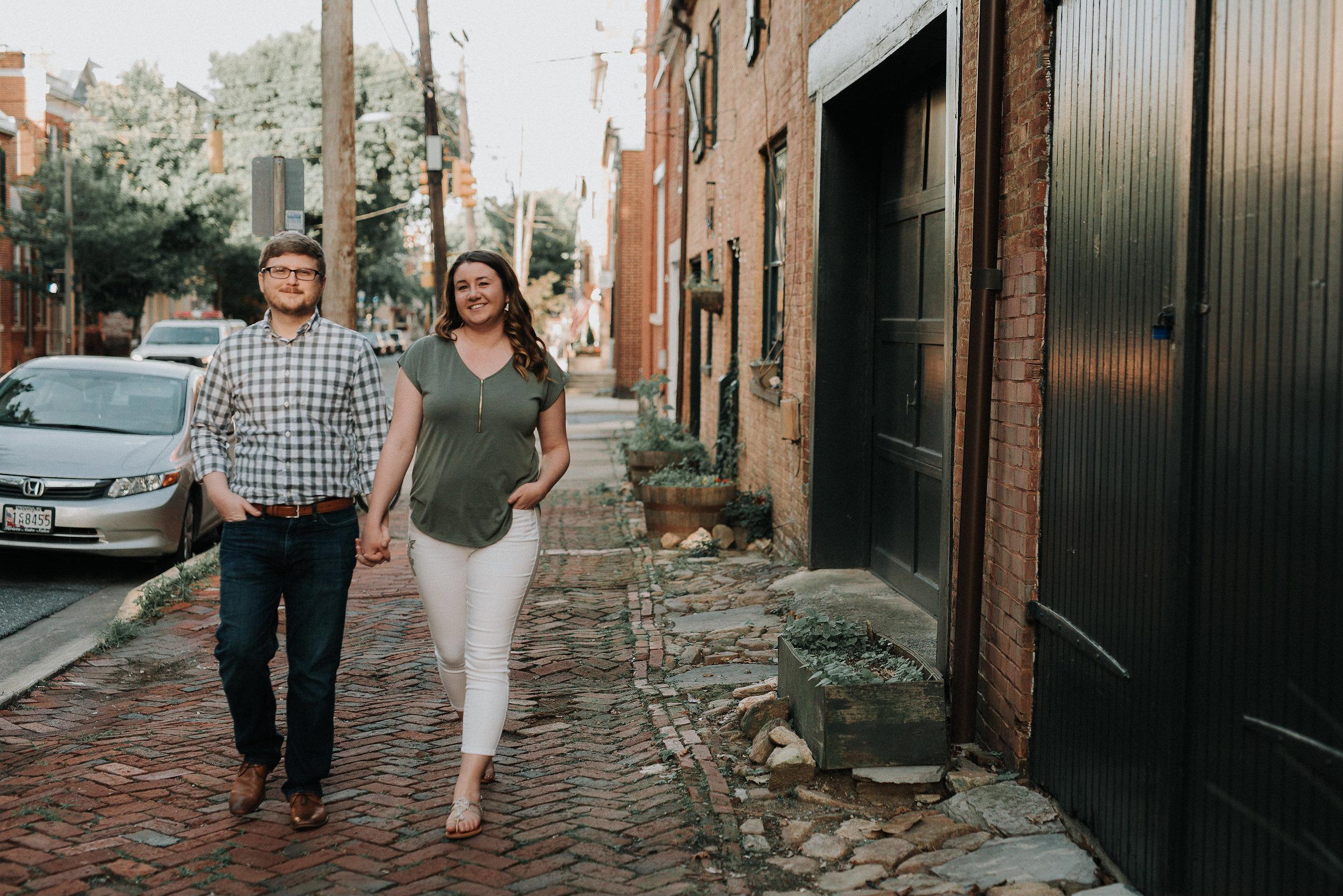 Couple walking on stone sidewalk