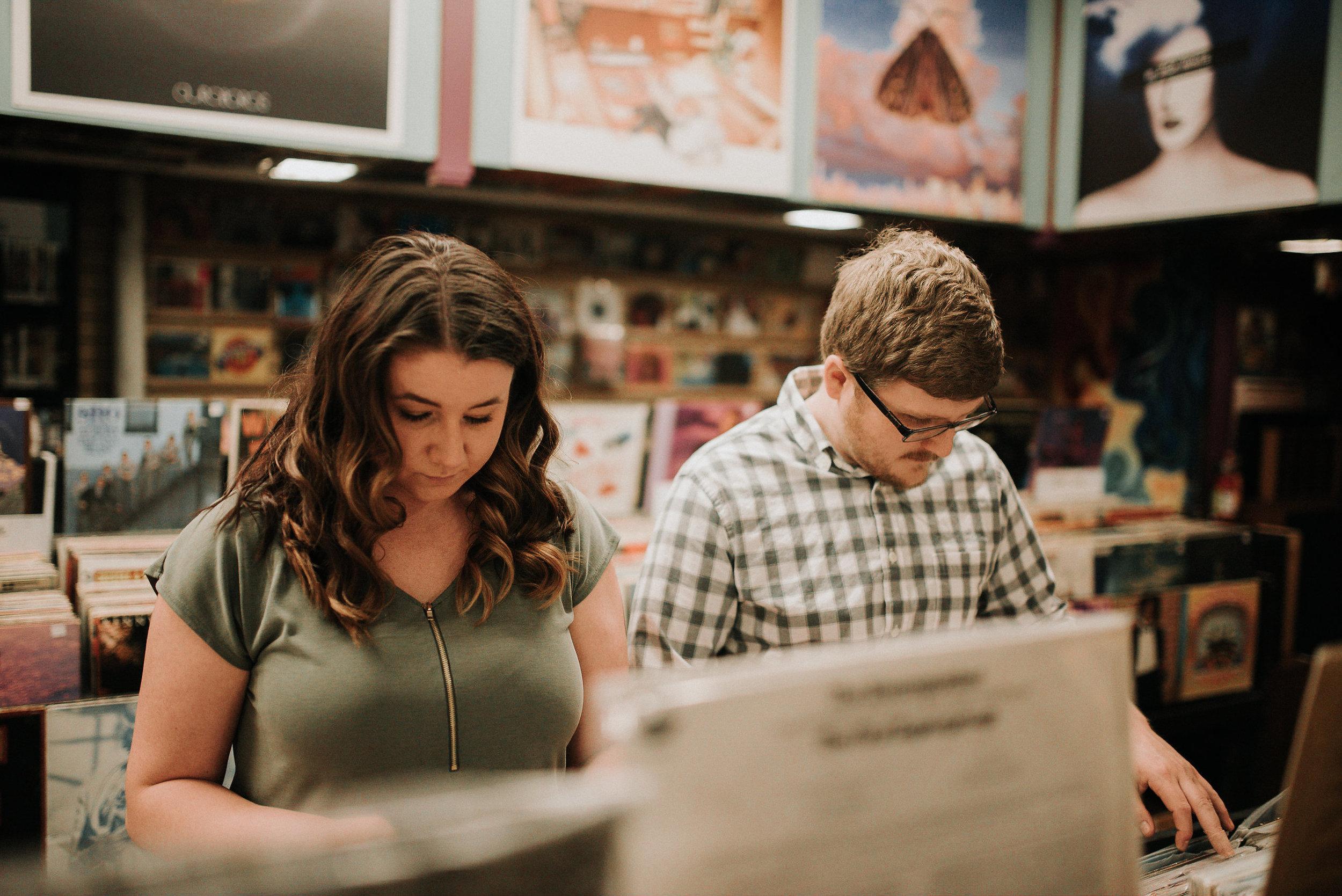 Couple flipping through records