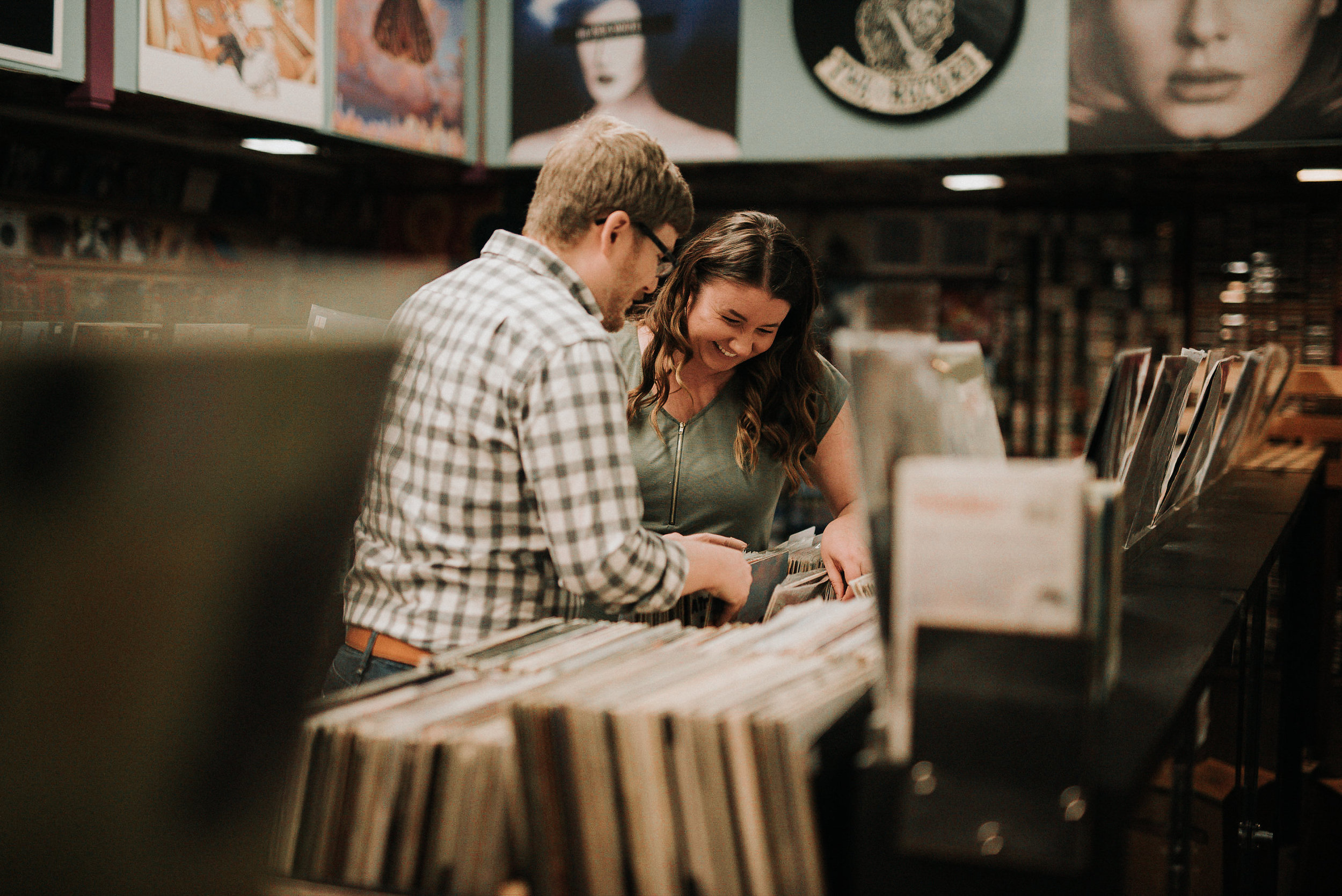 Couple laughing in record store