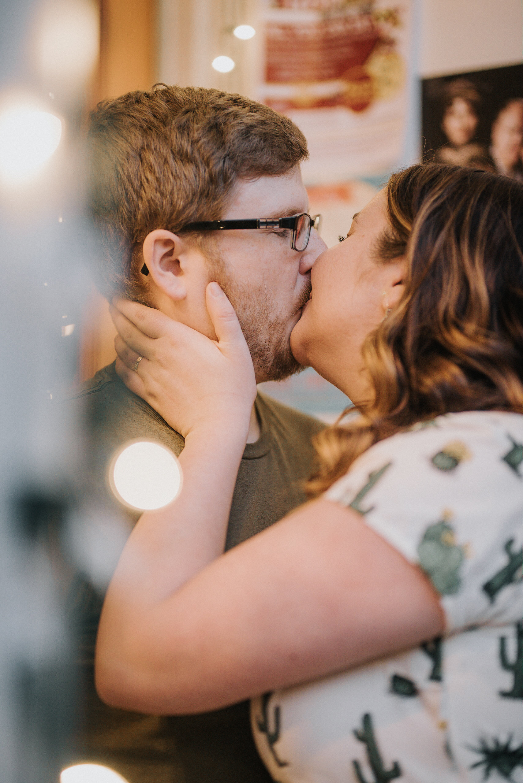 oman kissing man on doorstep