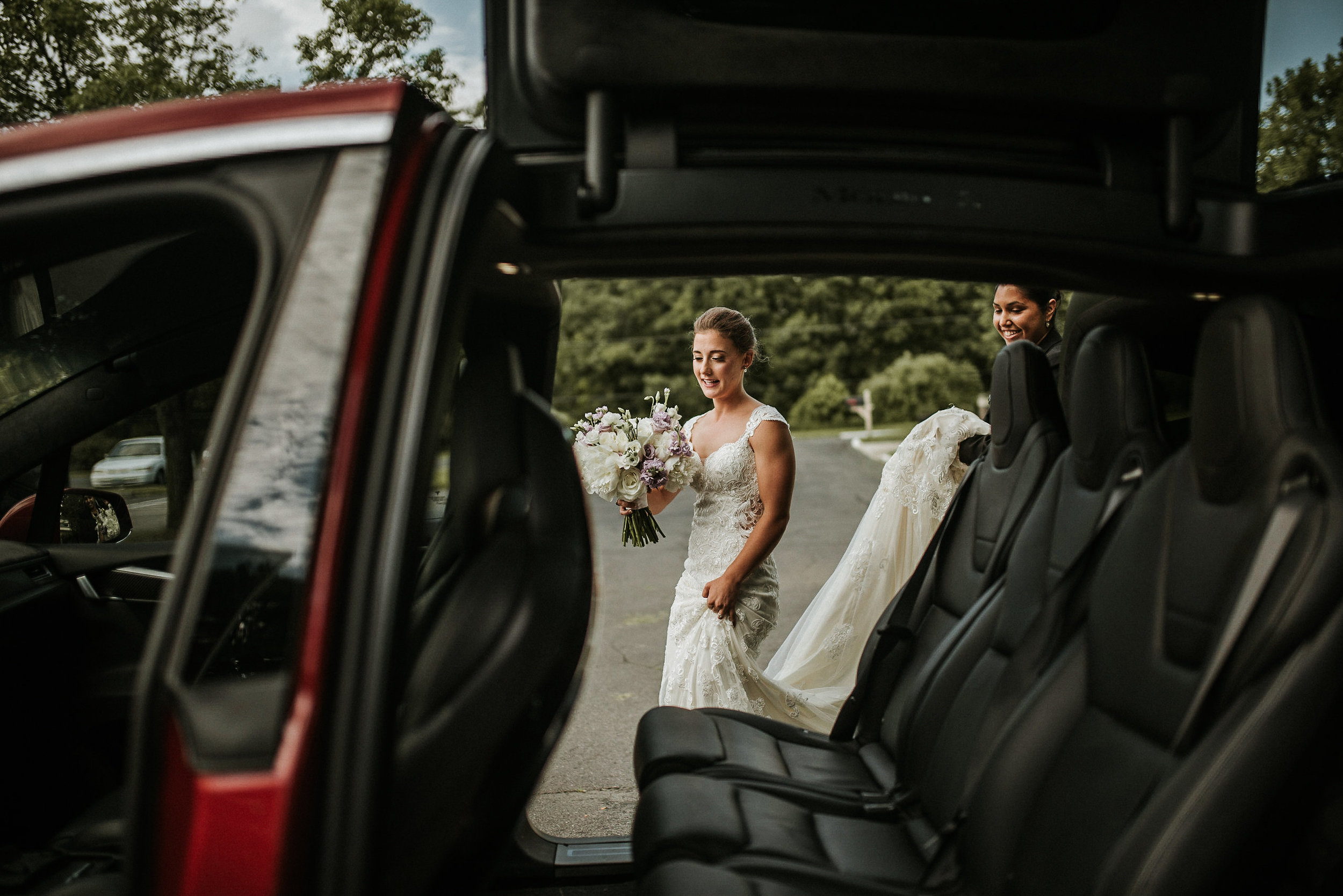Bride and groom getting into Tesla