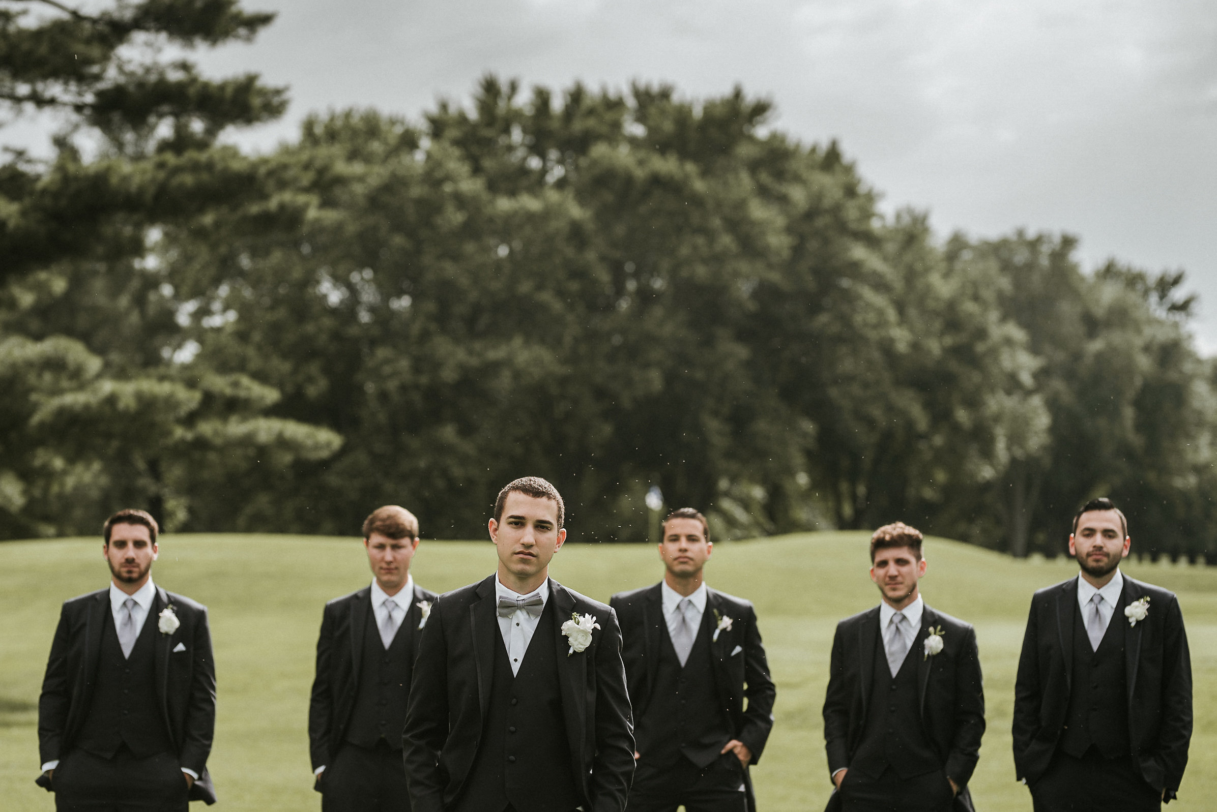 Groom and groomsmen on golf course