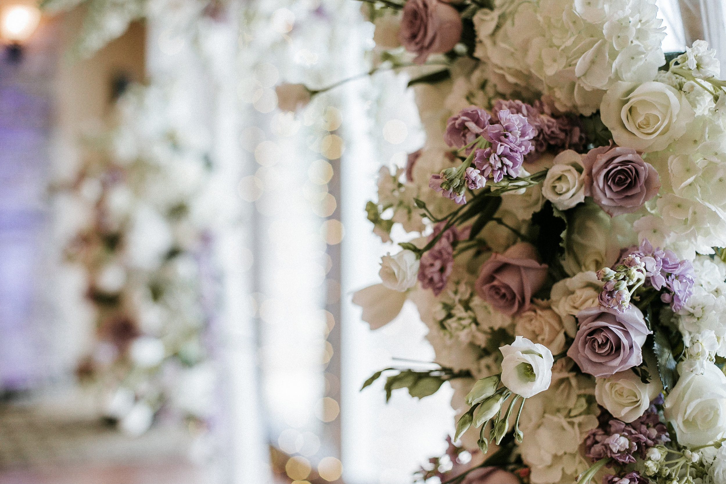 Flowers on arch at wedding