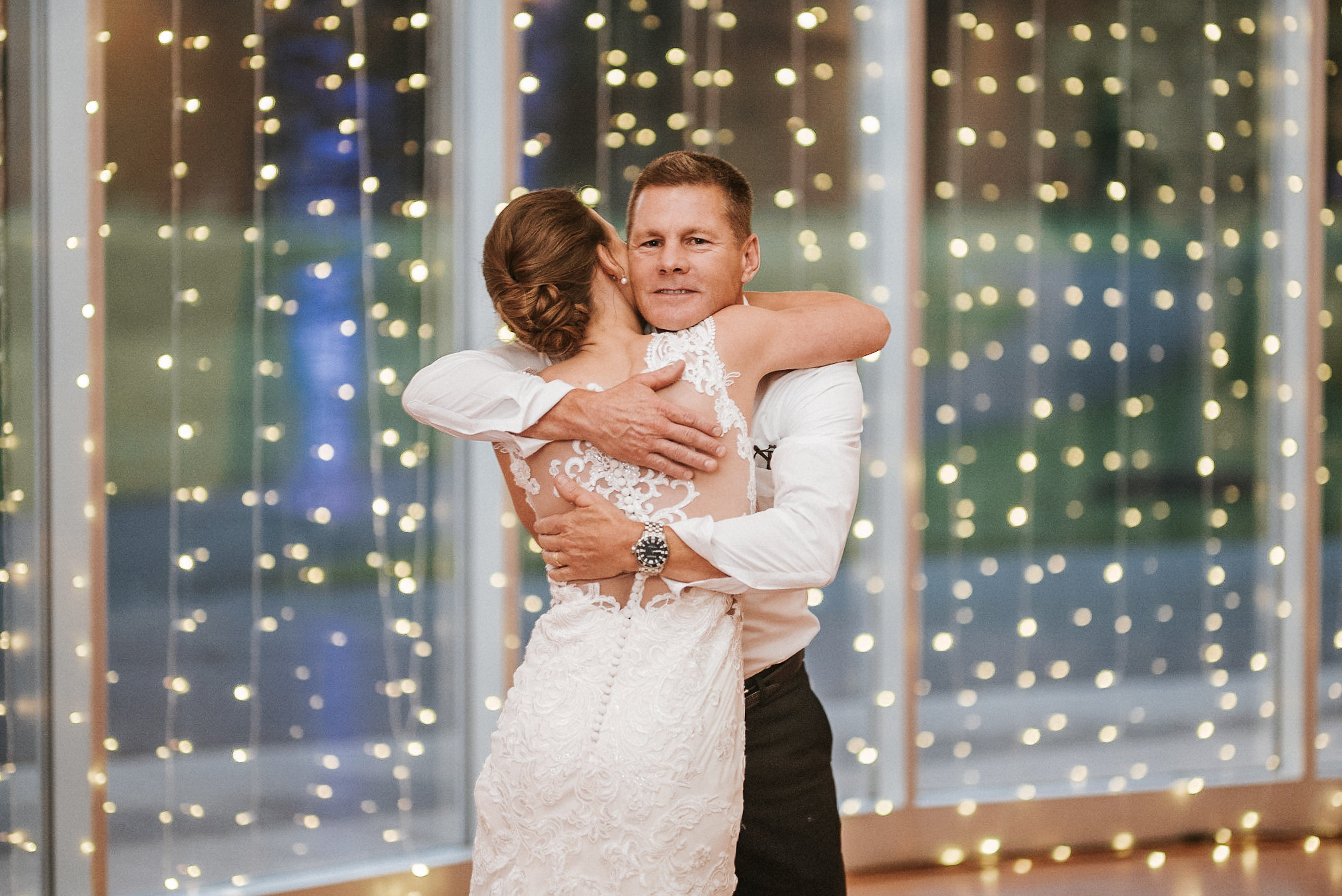 Father and daughter hugging during dance