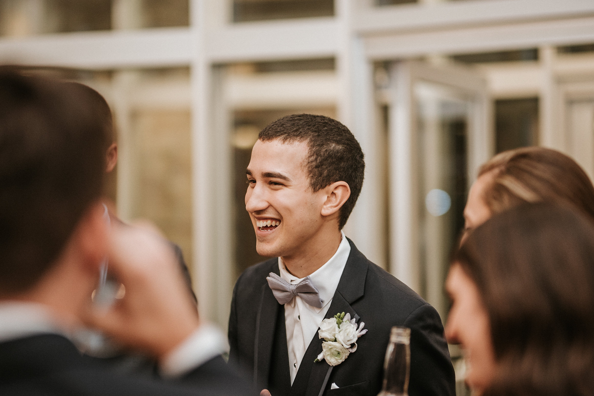Groom laughing at reception