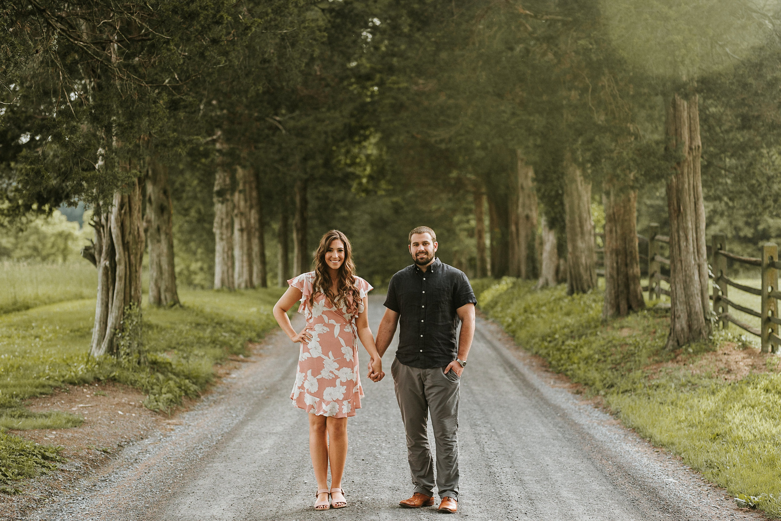 Man and woman standing on gravel road