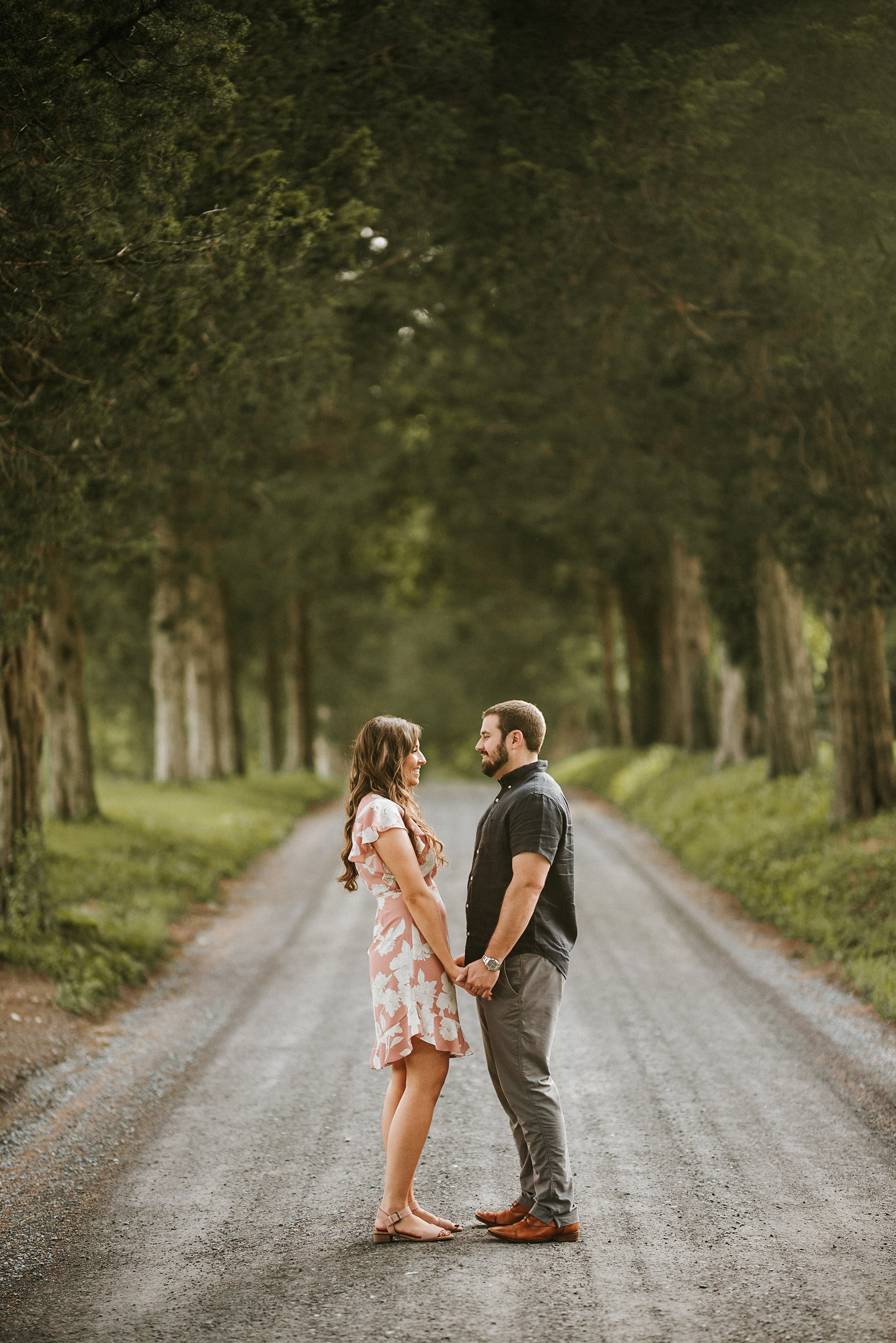 Couple standing in road facing one another