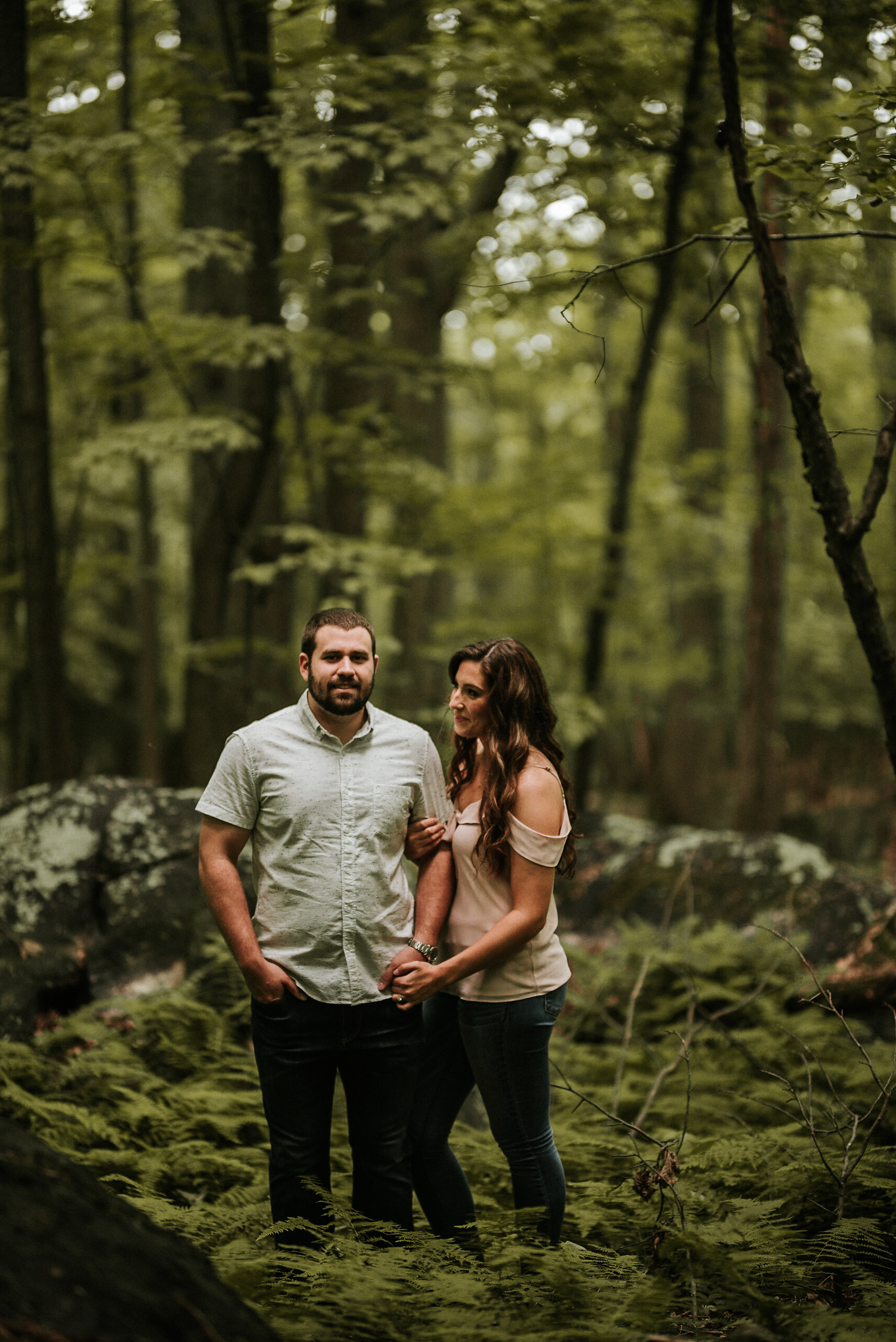 Man and woman in lush forest