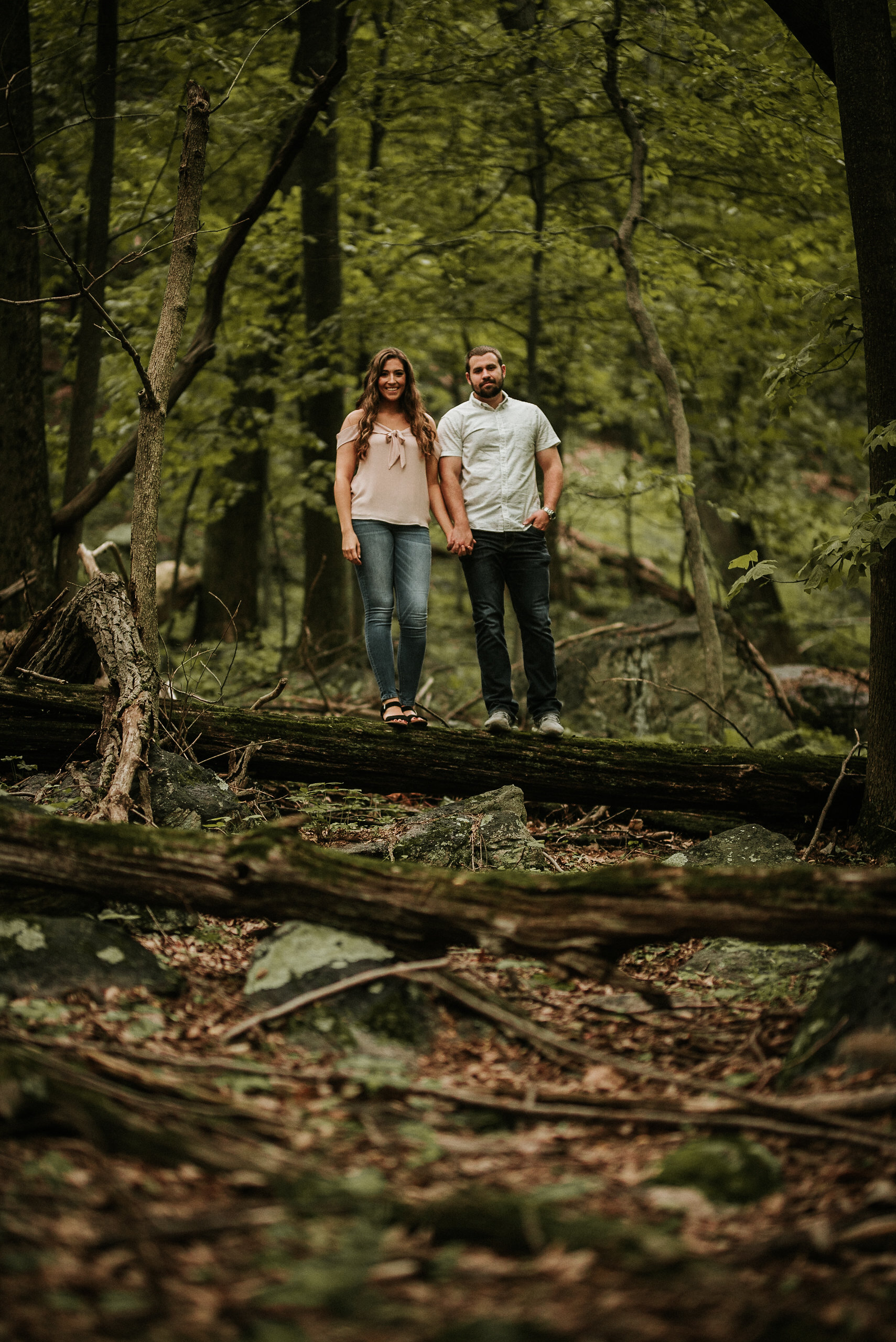 Couple standing on a log