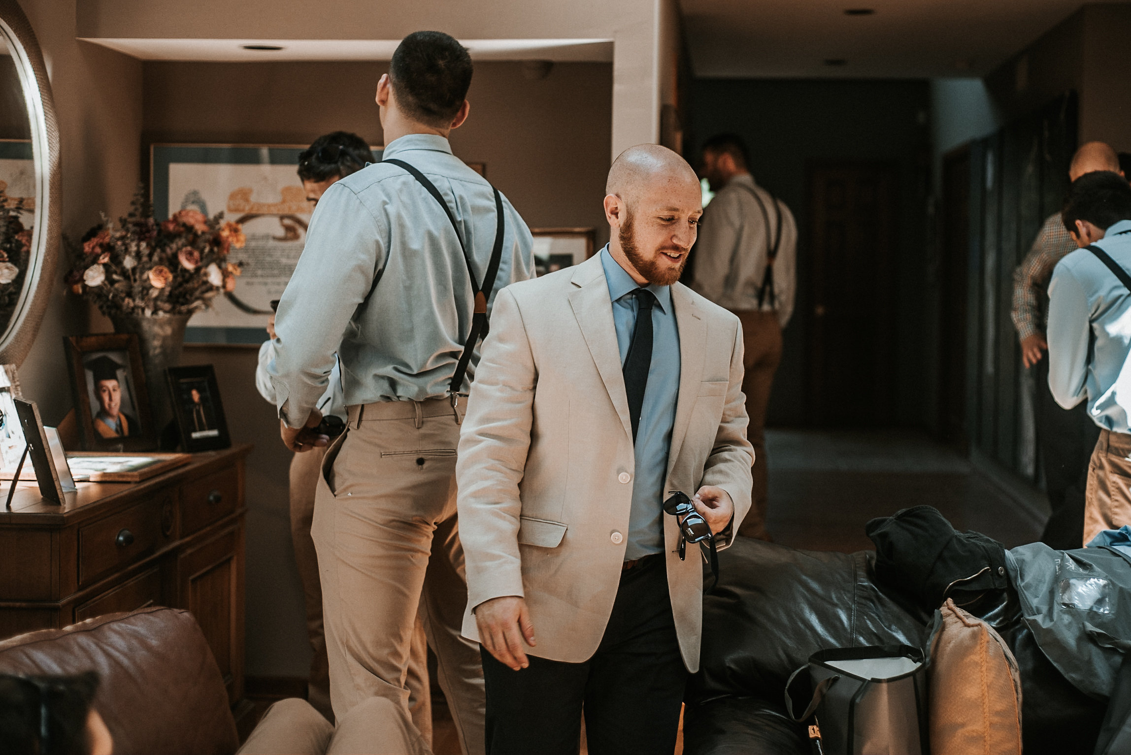 Groom getting ready for wedding in suite