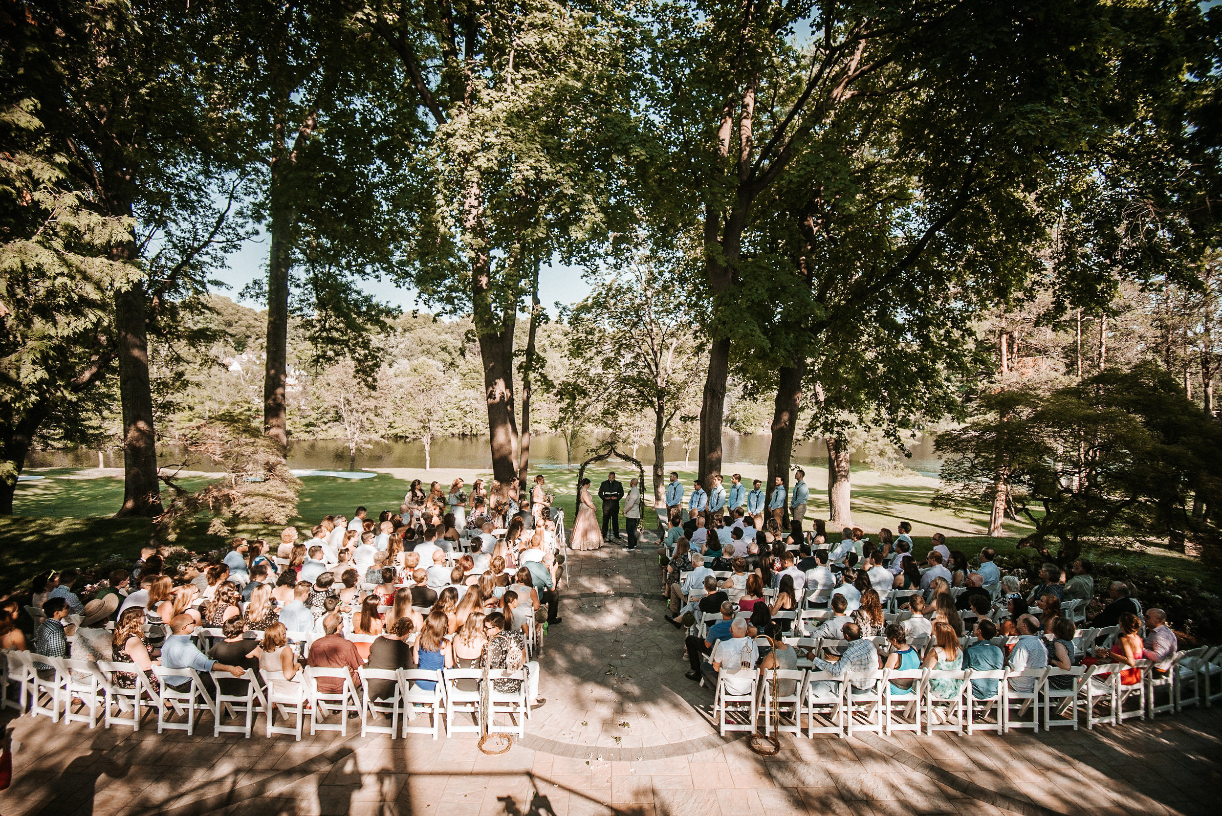 Shaded wedding ceremony space beside lake