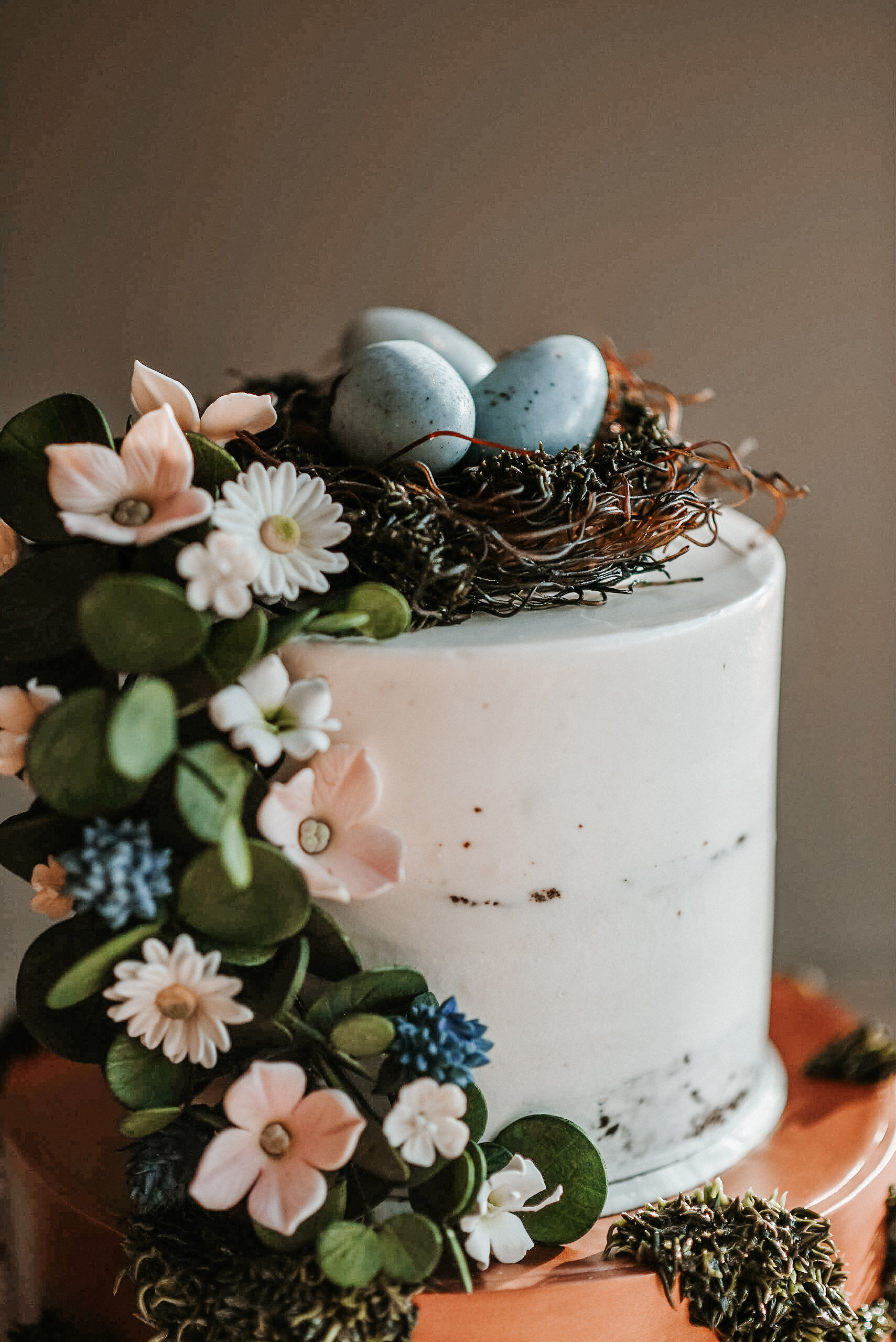 Top of wedding cake with robin's eggs