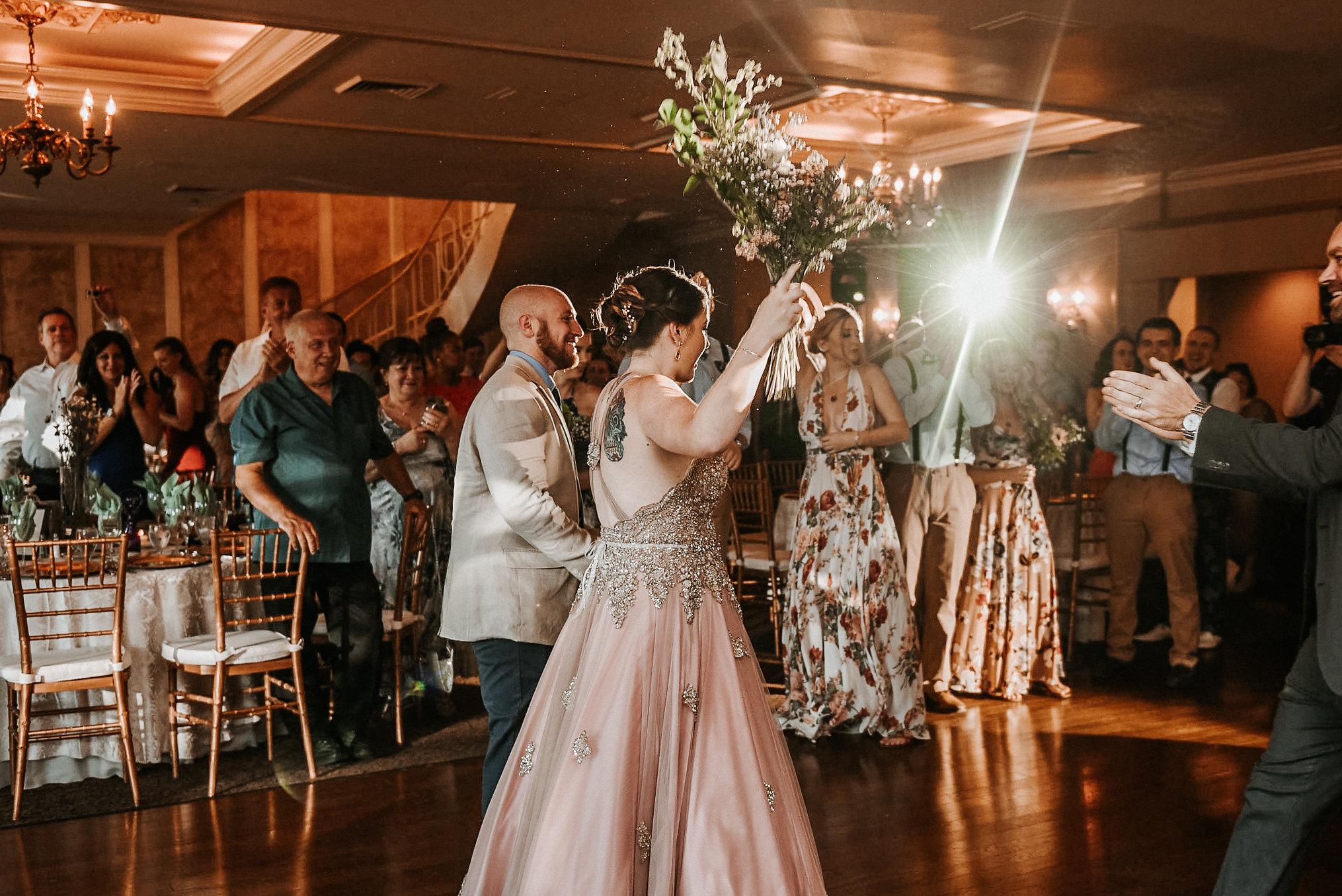 Bride and groom arriving at dance floor