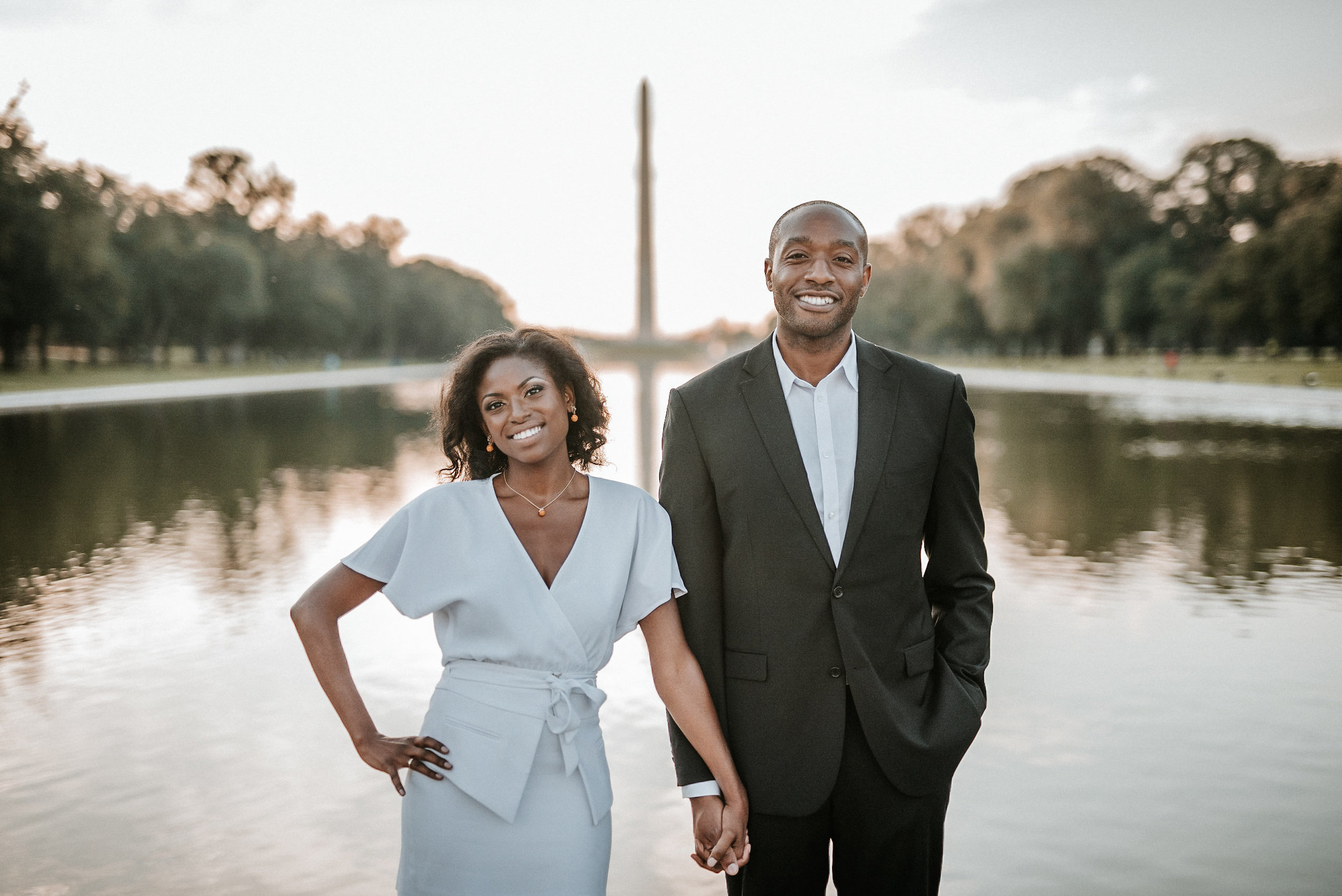 Couple standing by reflecting pool