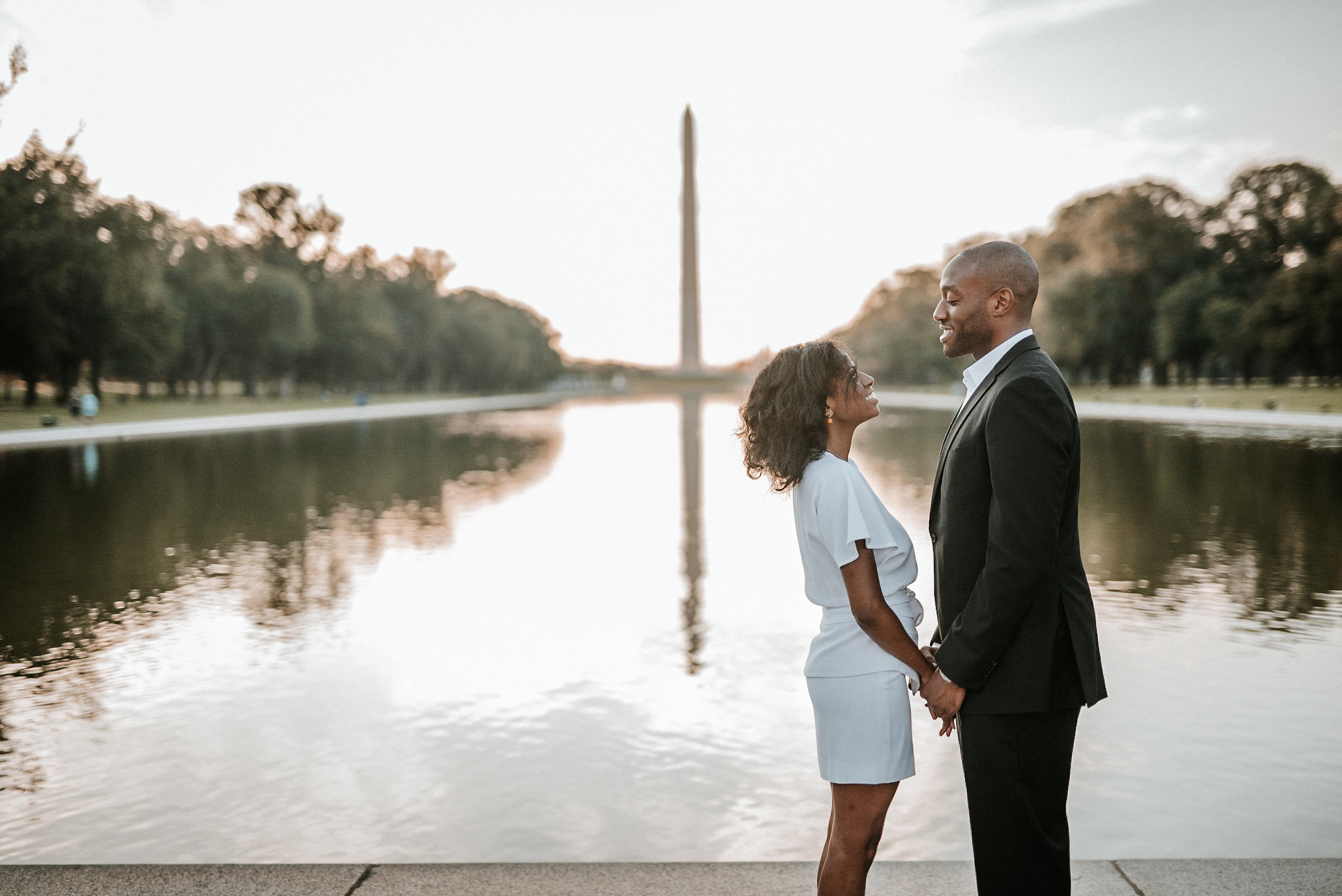 Couple posing in front of Washington Memorial