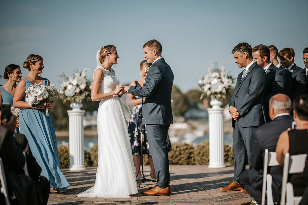 Bride and Groom exchanging rings at Crystal Point Yacht Club