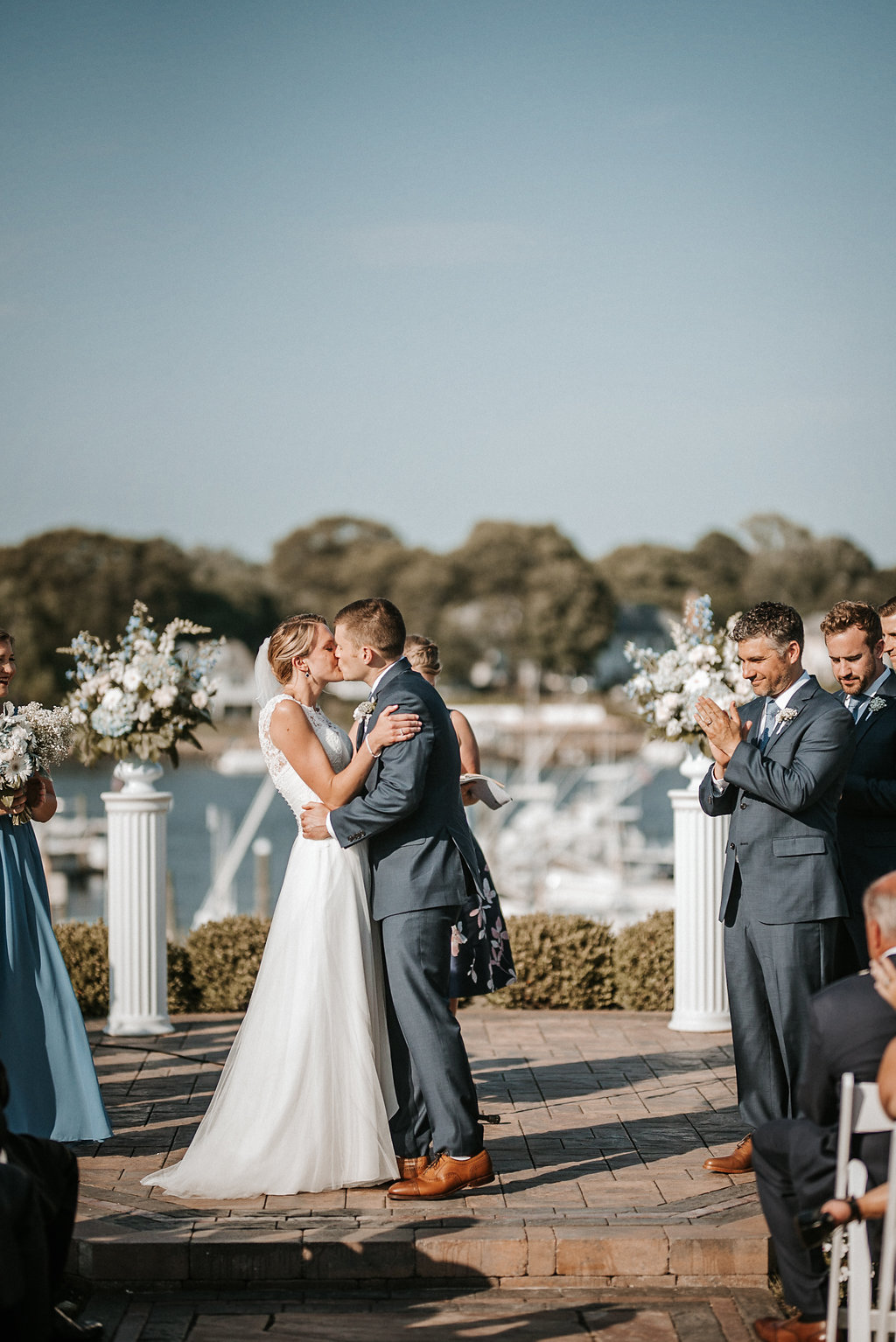 Bride and Groom kissing at Crystal Point Yacht Club