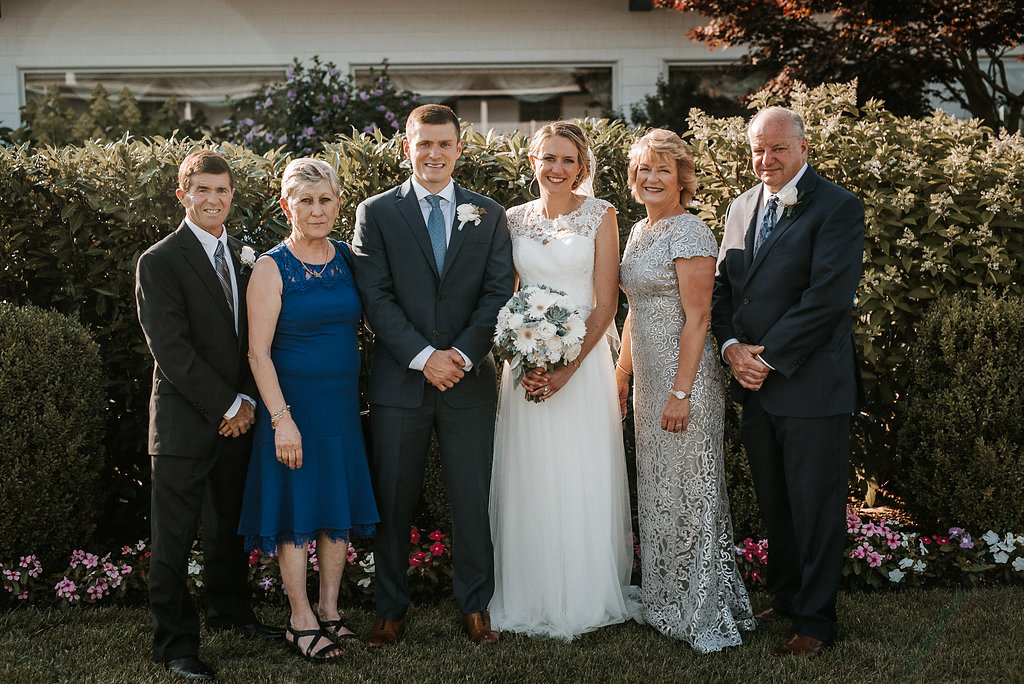 Family Picture with Bride and Groom at Crystal Point Yacht Club