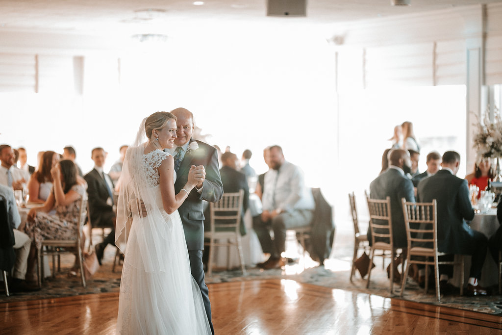 bride and her father dancing at crystal point yacht club