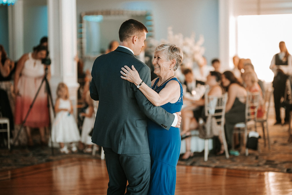 groom and his mother dancing at crystal point yacht club