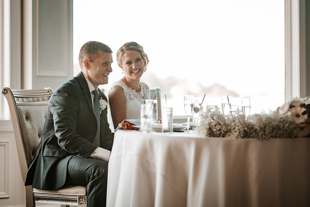 bride and groom toasting at crystal point yacht club